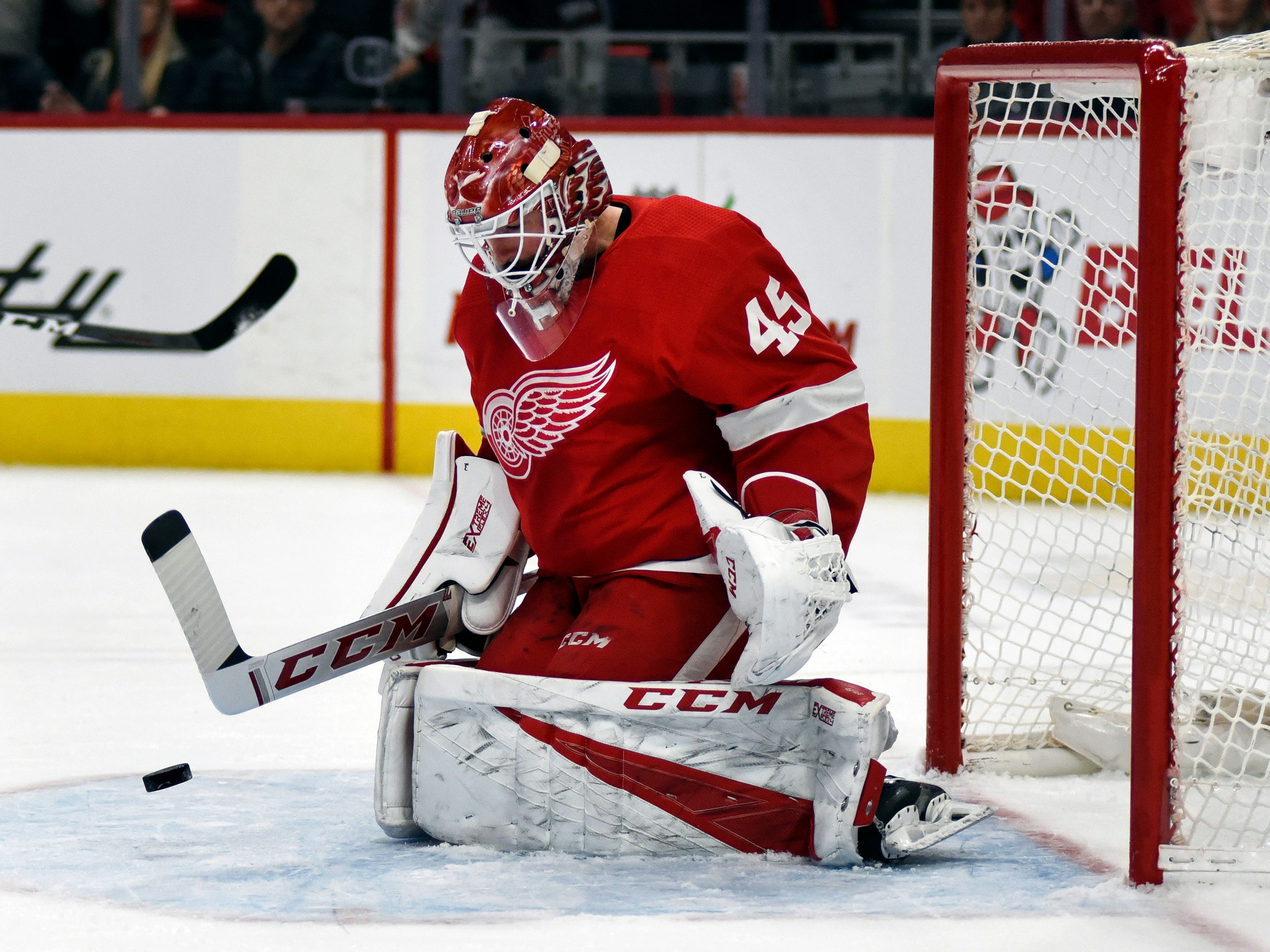 Detroit Red Wings goaltender Jonathan Bernier deflects a shot by the Colorado Avalanche in the first period of an NHL hockey game in Detroit, Sunday, Dec. 2, 2018.