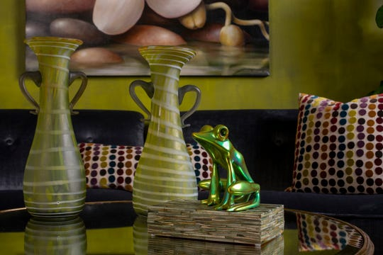 The frog paired with vases creates an appealing tableau.