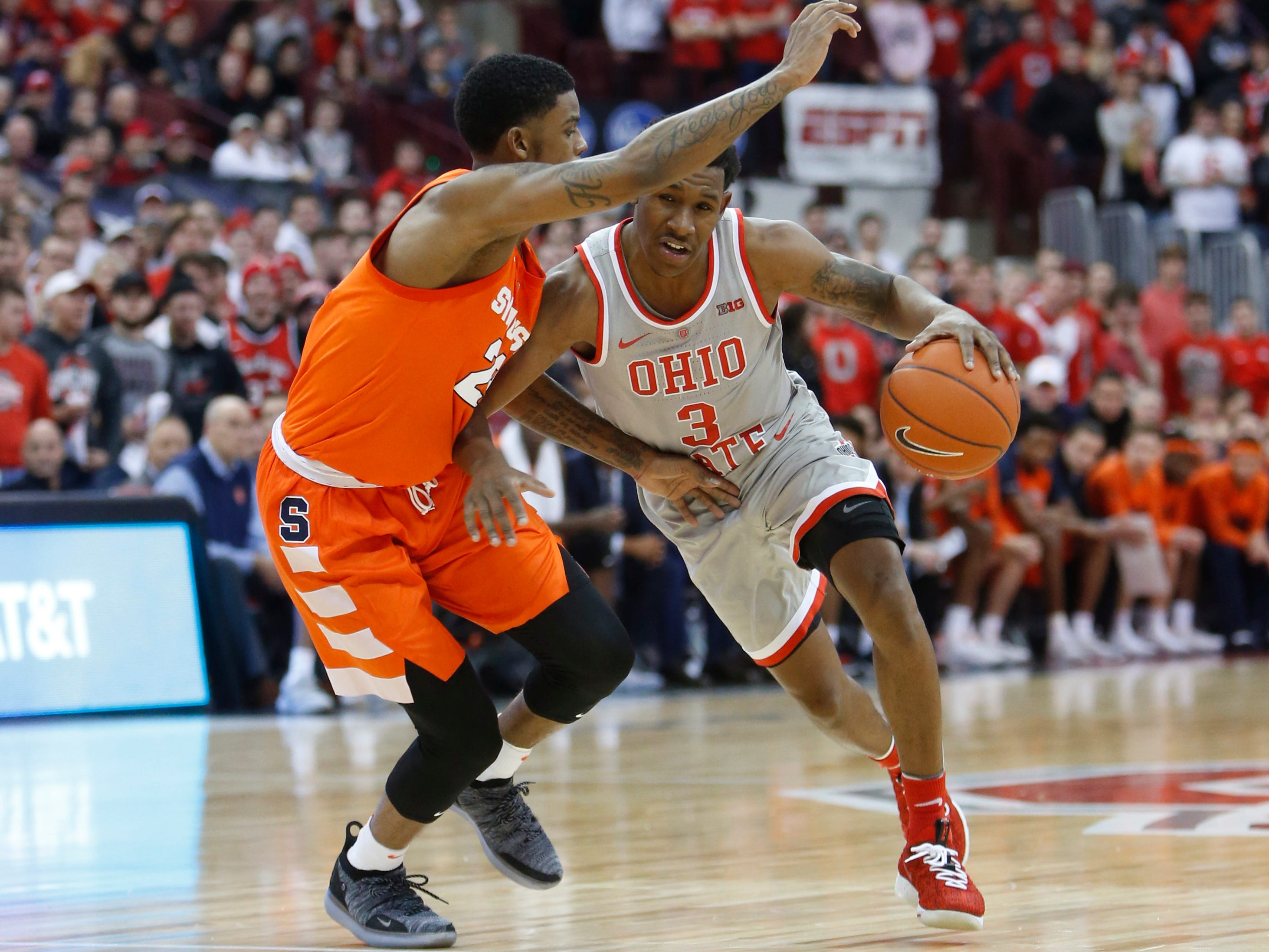 Ohio State's C.J. Jackson, right, drives to the basket against Syracuse's Frank Howard during the second half of an NCAA college basketball game Wednesday, Nov. 28, 2018, in Columbus, Ohio. Syracuse defeated Ohio State 72-62. (AP Photo/Jay LaPrete)
