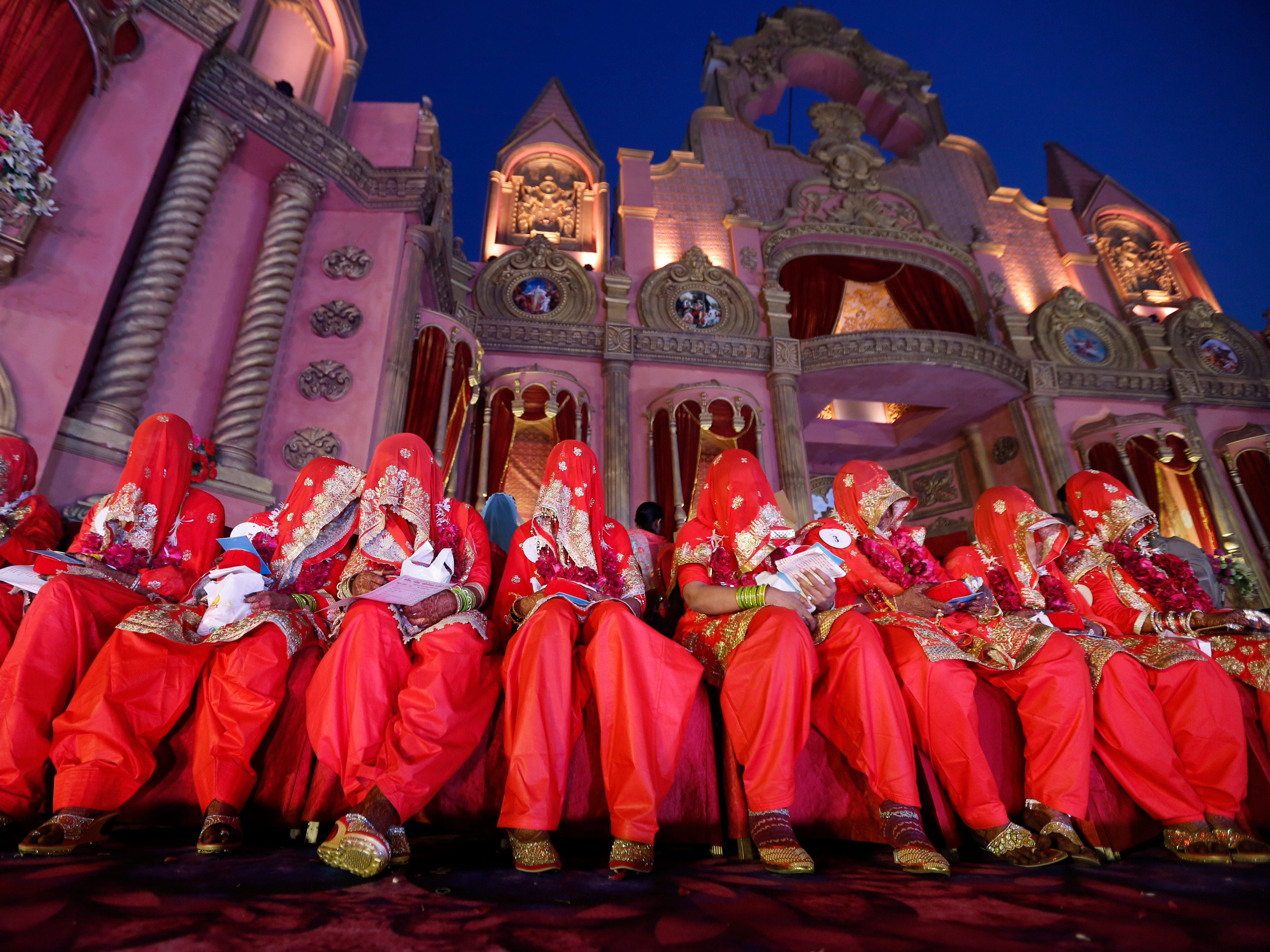Muslim brides sit during a mass wedding where 65 couples were married in Ahmadabad, India, Monday, Dec. 3, 2018. Mass weddings in India are organized by social organizations primarily to help families who cannot afford the high ceremony costs as well as the customary dowry and expensive gifts that are still prevalent in many communities.
