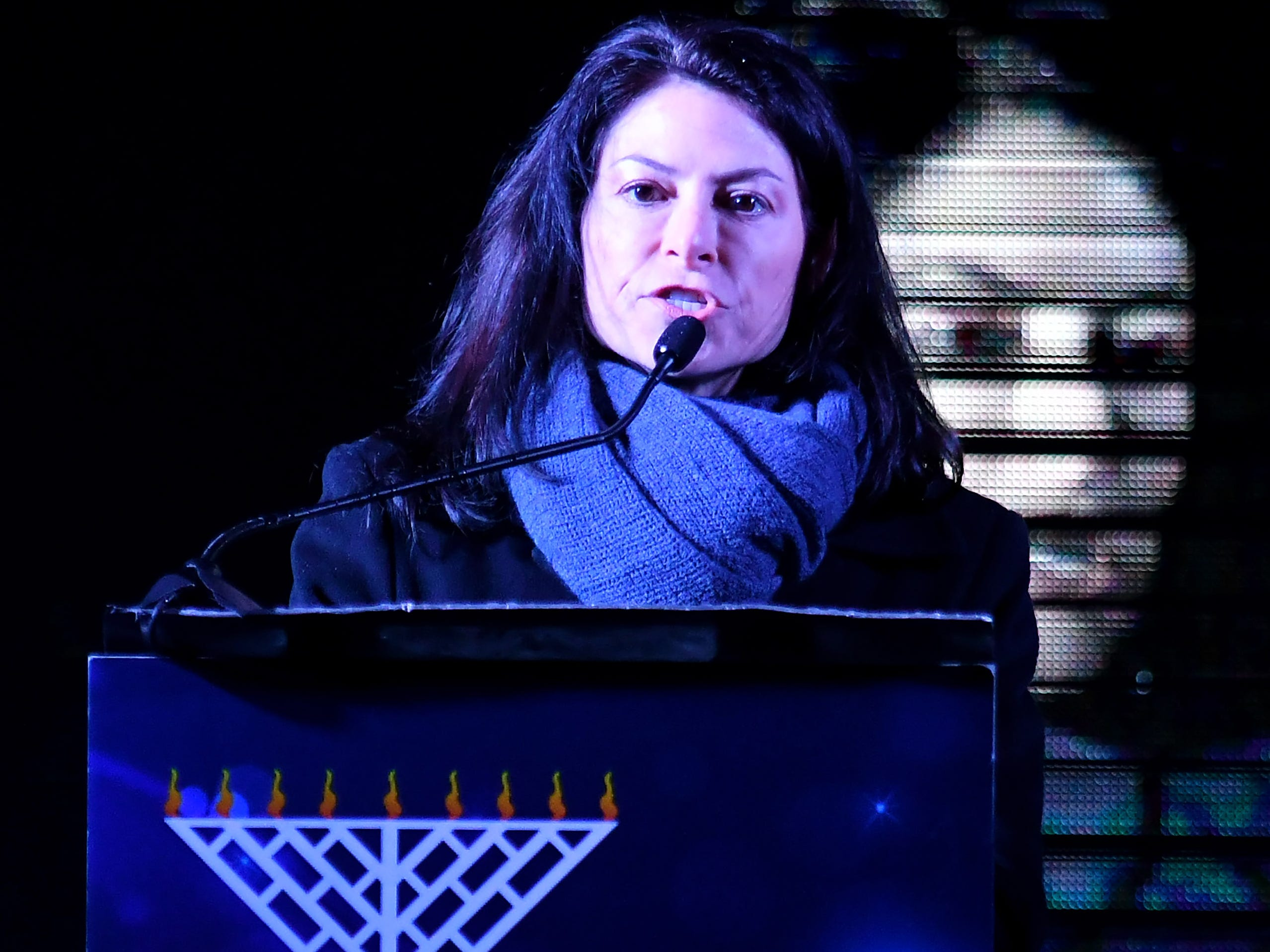 Michigan attorney general elect Dana Nessel speaks at the Menorah in the D celebration.