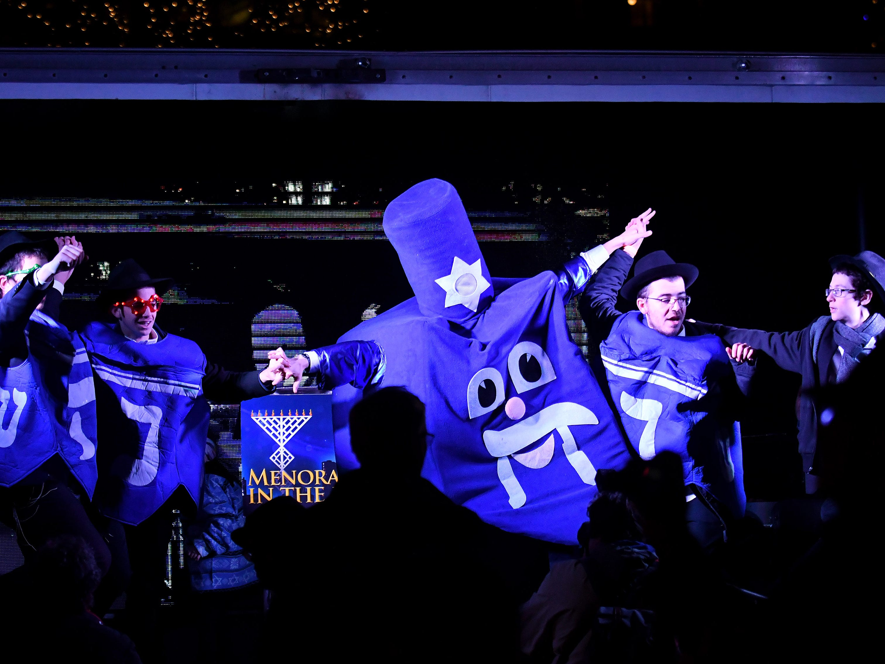 Students from the Chabad Yeshivah school in Oak Park sing and dance at the Menorah in the D celebration at Campus Martius.