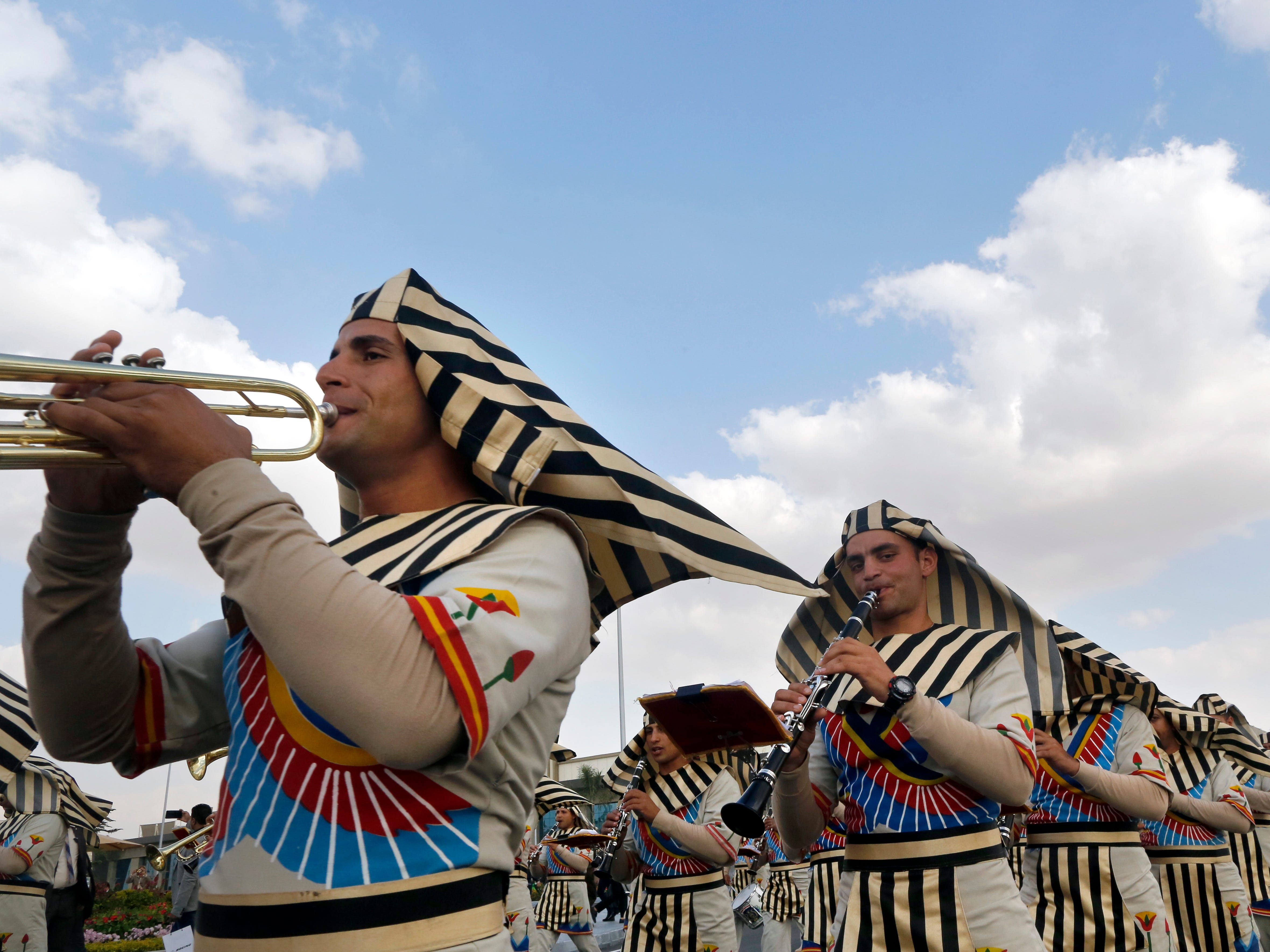 Members of an Army band wear Pharaonic costumes during the opening of the first arms fair organized in Cairo, Egypt, Monday, Dec. 3, 2018. Egypt's President Abdel-Fattah el-Sissi inaugurated the fair, where hundreds of companies are participating.