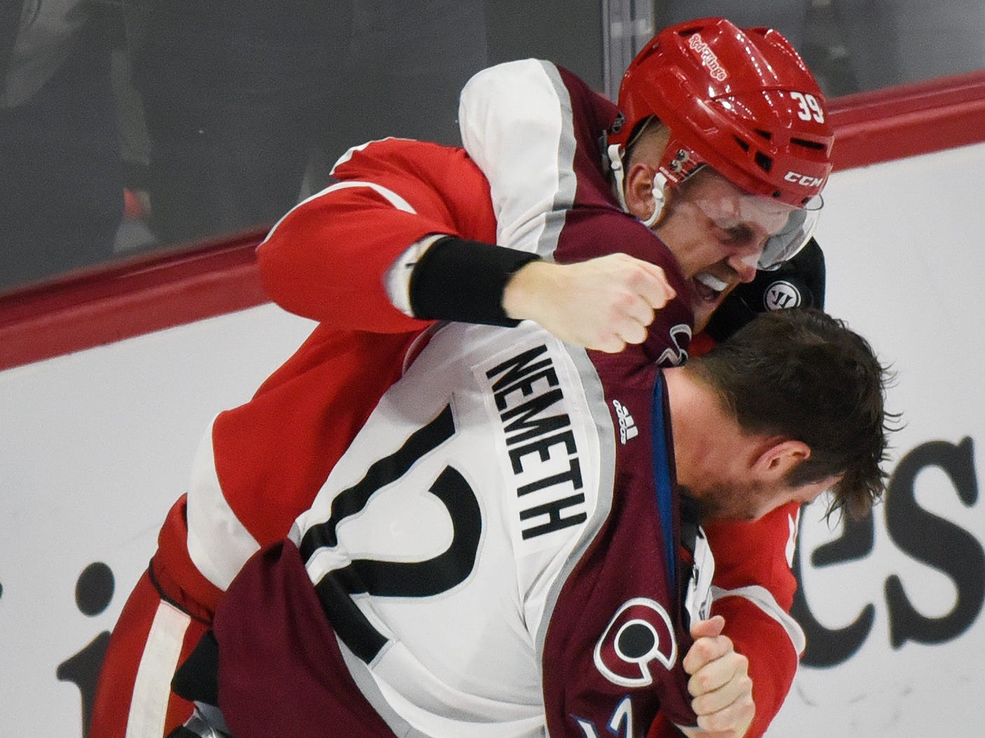 Detroit Red Wings' Anthony Mantha fights with Colorado Avalanche defenseman Patrik Nemeth (12) of Sweden during the third period.