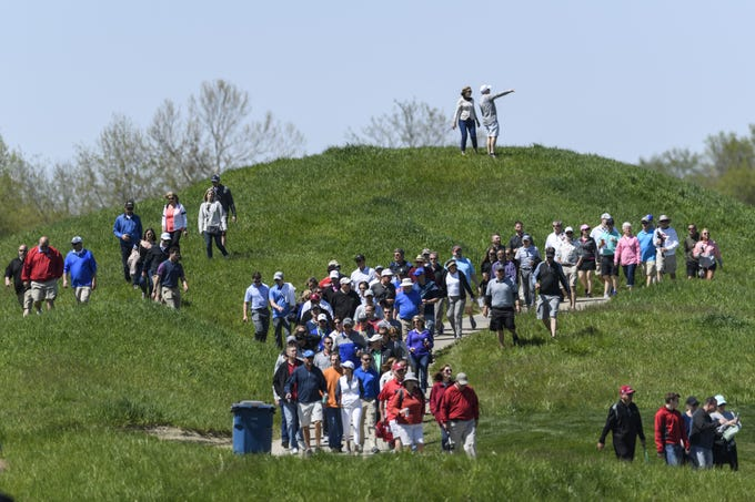 A large crowd of spectators follow the leaders to the 9th hole green during the final round of the United Leasing & Finance Championship at Victoria National Golf Club in Newburgh, Ind., Sunday, April 29, 2018.