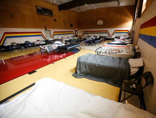 Beds for homeless people fill a room Friday, Nov. 30, at the Salvation Army in Fond du Lac.