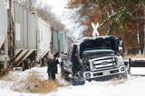 A pick-up truck and train collided in the village of Brandon sending a woman to the hospital via Flight For Life.