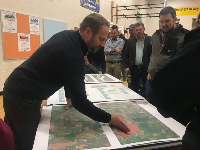 Ben Basalay, RB+B Architects Project manager, answers community questions about the new Wellington middle/high school Nov. 28. The project drawings are conceptual at this point, but architects explained their vision and asked for feedback.