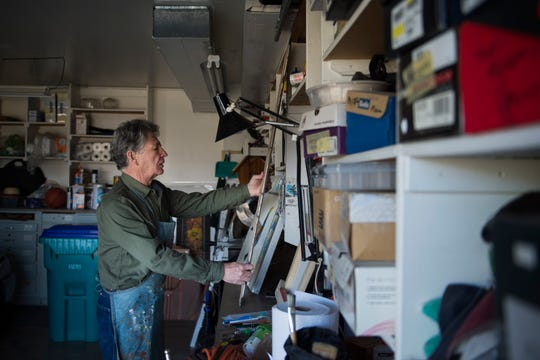 Neighbor to Neighbor Homeshare program renter Tim Merrick moves one of his paintings on the workbench on Monday, Dec. 3, 2018, in the garage of the home eat he rents living space in near Terry Lake in Fort Collins, Colo. Merrick, who recently moved from Tucson, Ariz. to be closer his children, is able to utilize garage space in the home where he rents a room to continue his painting and woodworking.