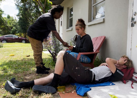 Case worker Ramona Miller greets Jessica Weatherley and her boyfriend Brian Cooper at her sisters North Fort Myers home. The two are fentanyl addicts and had made a phone call to Miller to get into detox.