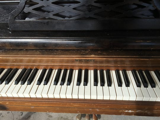 The keys of this crossroads piano in Alva may be a little battered, but they still make music