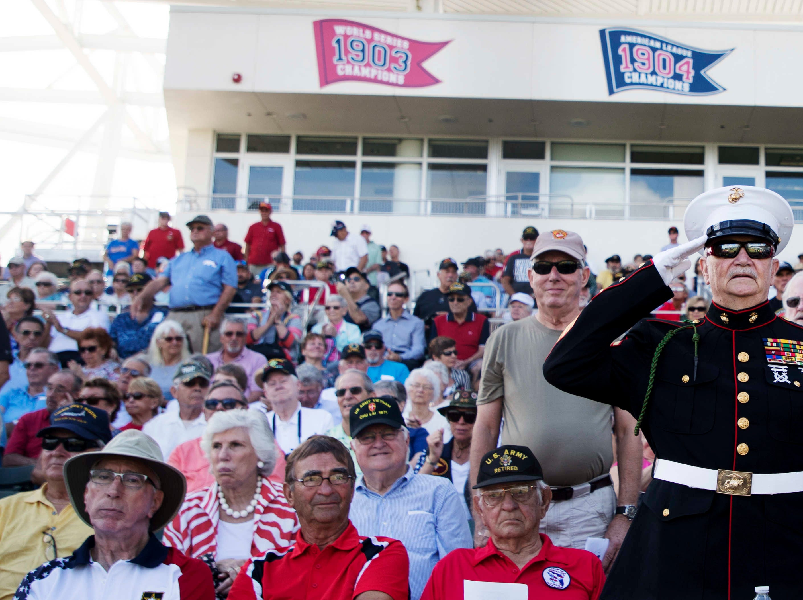 Marine veteran McClure Mathews salutes during a Collier-Lee Honor Flight veterans ceremony at jetBlue Park on Monday 11/12/2018. Veterans from all services who fought in the Vietnam War were honored with a Vietnam Veterans War Commemorative pin during the ceremony. Mathews served two tours in Vietnam.