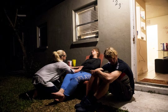 Willie Weatherley, left,  pleads with he sister, Jessica Weatherley to enter a detox center. Weatherley and her  boyfriend, Brian Cooper are addicted to Fentanyl. Over a course of several hours they called detox centers and learned there were no availability. At the end, they decided to hit the streets again.