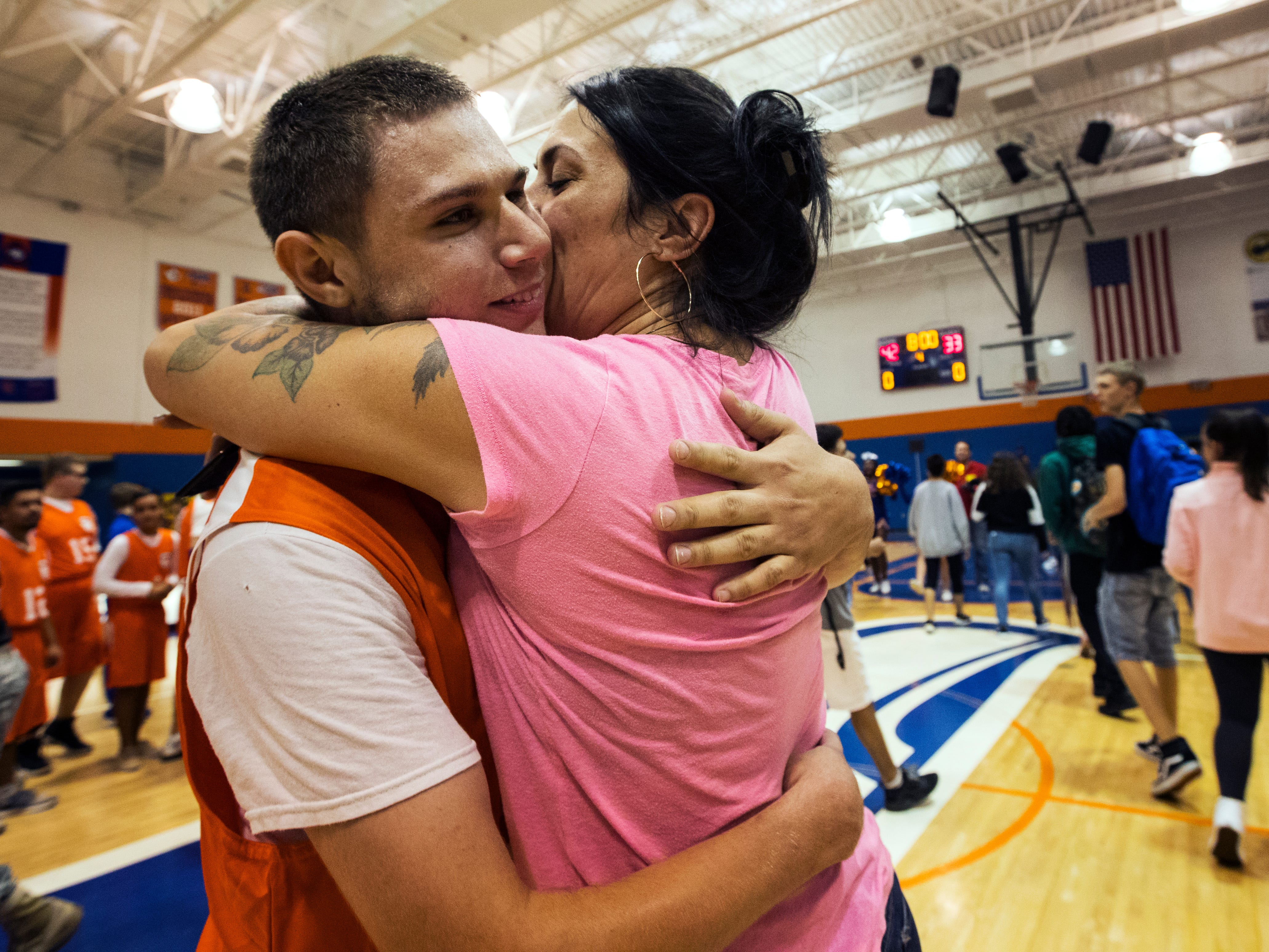 Cape Coral High School student-athlete Luis Duran, 17, gets a kiss from his mother, Penelope Rodriguez, after facing Mariner High Friday morning, November 16, 2018. Duran was a key player for the team's victory against Mariner High School. The two schools faced off in a Unified sports basketball game. Lee County schools have significantly expanded the size, reach and potential impact of its Special Olympics commitment this year with the addition of what is known as Unified sports, in which students with and without disabilities work together on organized teams for a season. A number of Lee County high schools are participating this first year and are playing already in basketball, one of four high school Special Olympics sports. Track and field will be held in the spring. Flag football and soccer will be added in the future and reach the middle school level. The goal: greater participation, inclusion and understanding.