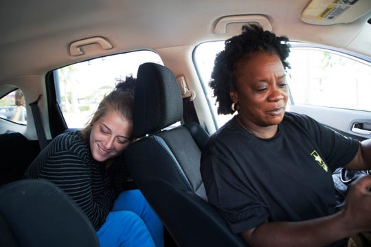 Ramona Miller makes phone calls to detox centers for Jessica Weatherley.