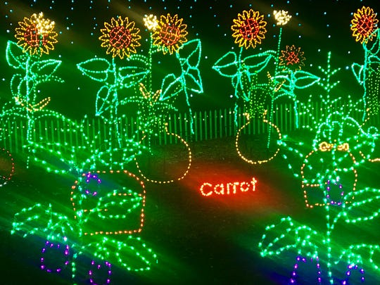 The new display at this year's WPS Garden of Lights at Green Bay Botanical Garden is a colorful vegetable patch.