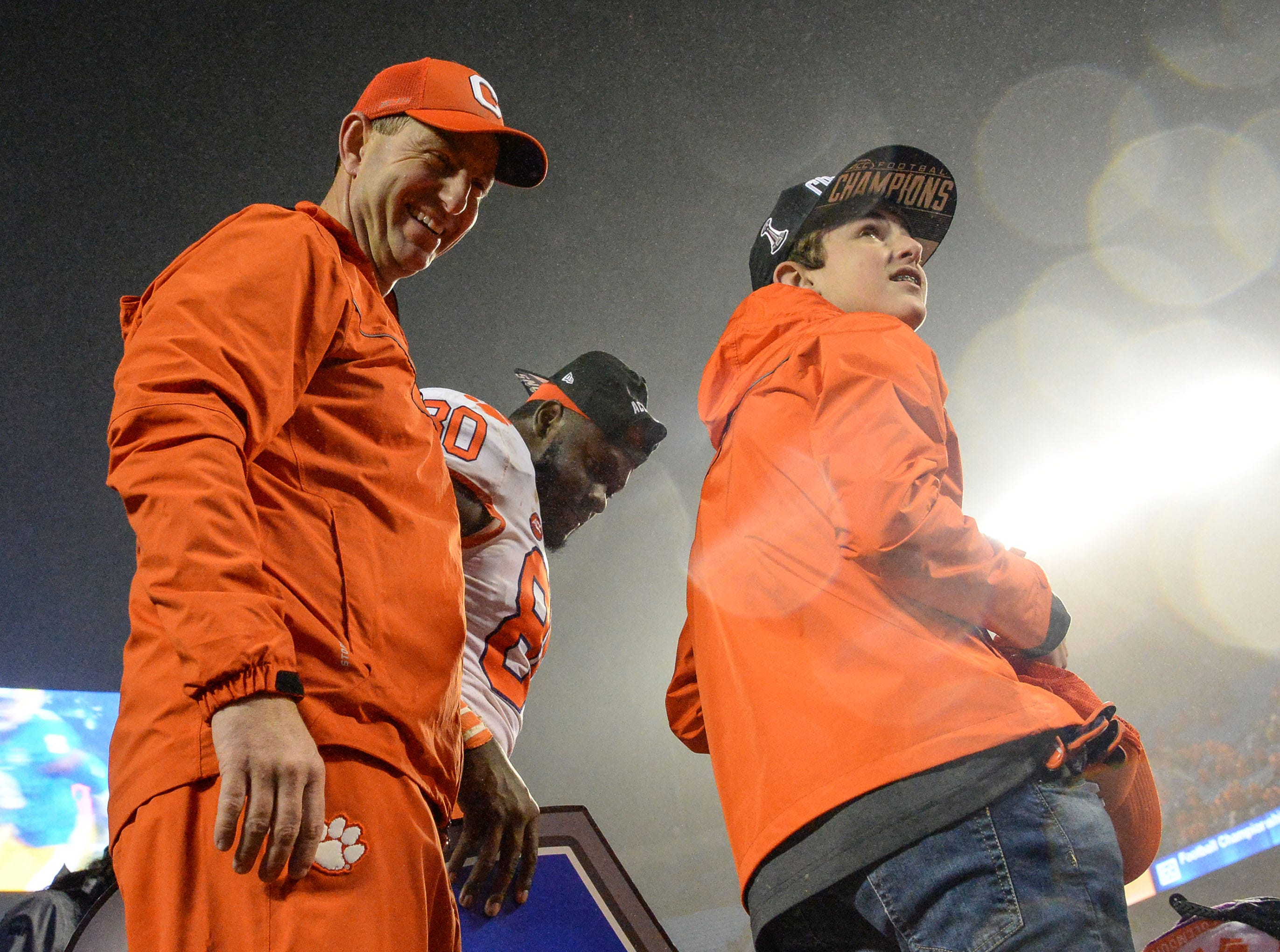 Clemson Head Coach Dabo Swinney and son Clay Swinney join team and fans celebrating a 42-10 win over Pittsburgh after the game at the Dr. Pepper ACC football championship at Bank of America Stadium in Charlotte, N.C. on Saturday, December 1, 2018.