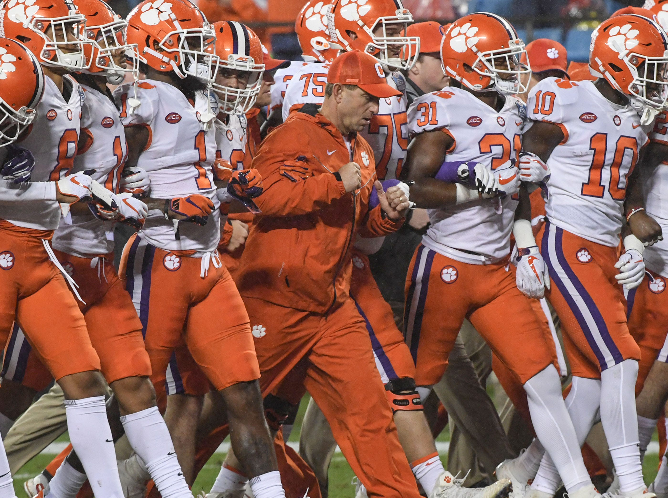 Clemson Head Coach Dabo Swinney and players walk together before the game of the Dr. Pepper ACC football championship at Bank of America Stadium in Charlotte, N.C. on Saturday, December 1, 2018.