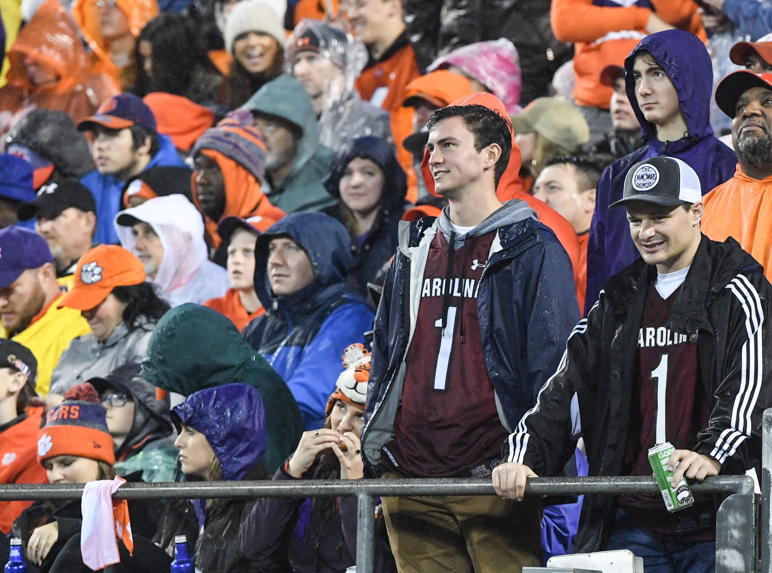 Two South Carolina fans watch the Clemson and Pittsburgh game during the second quarter of the Dr. Pepper ACC football championship at Bank of America Stadium in Charlotte, N.C. on Saturday, December 1, 2018.