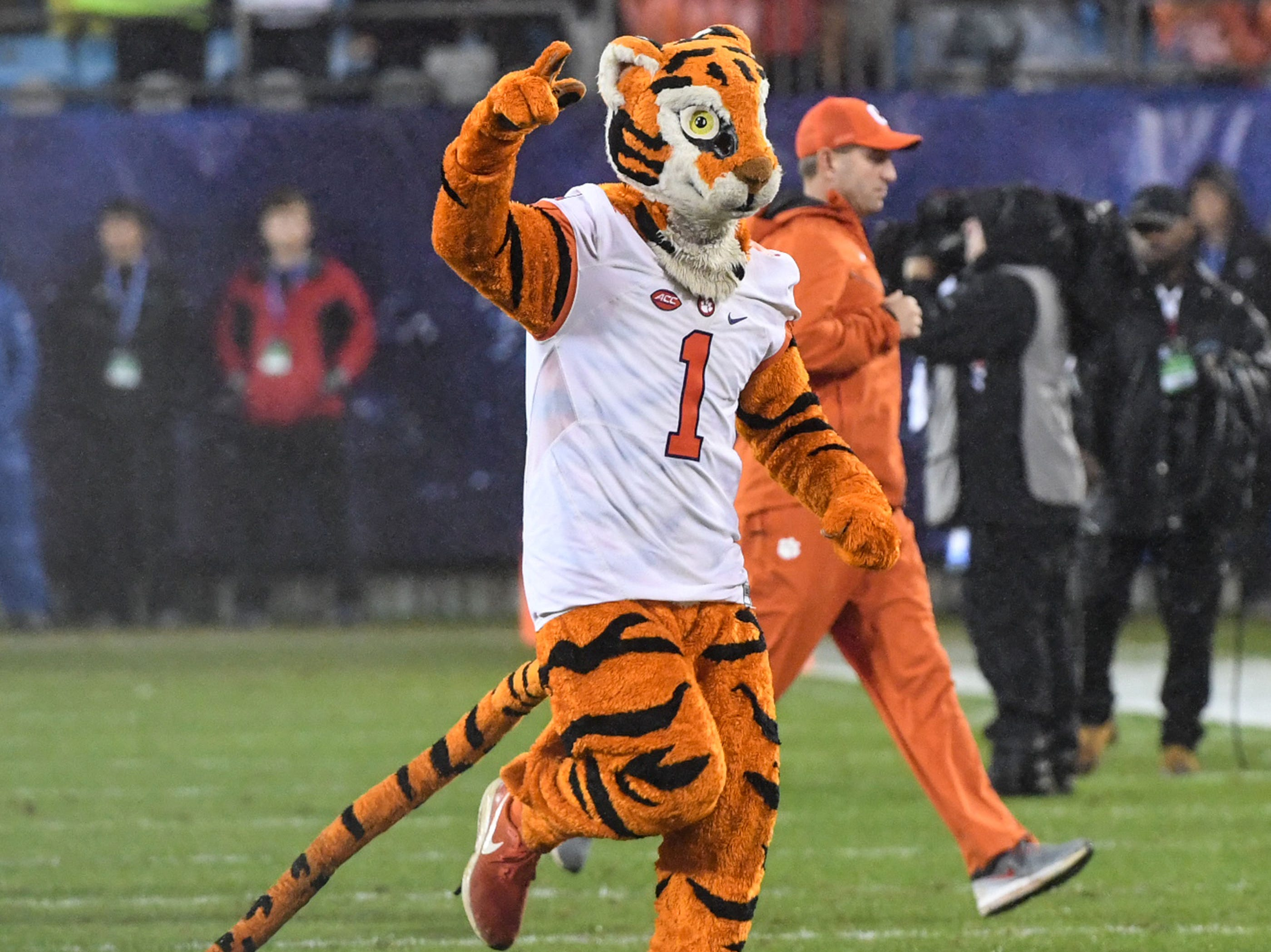 Clemson Head Coach Dabo Swinney and the Tiger run on the field before the game of the Dr. Pepper ACC football championship at Bank of America Stadium in Charlotte, N.C. on Saturday, December 1, 2018.