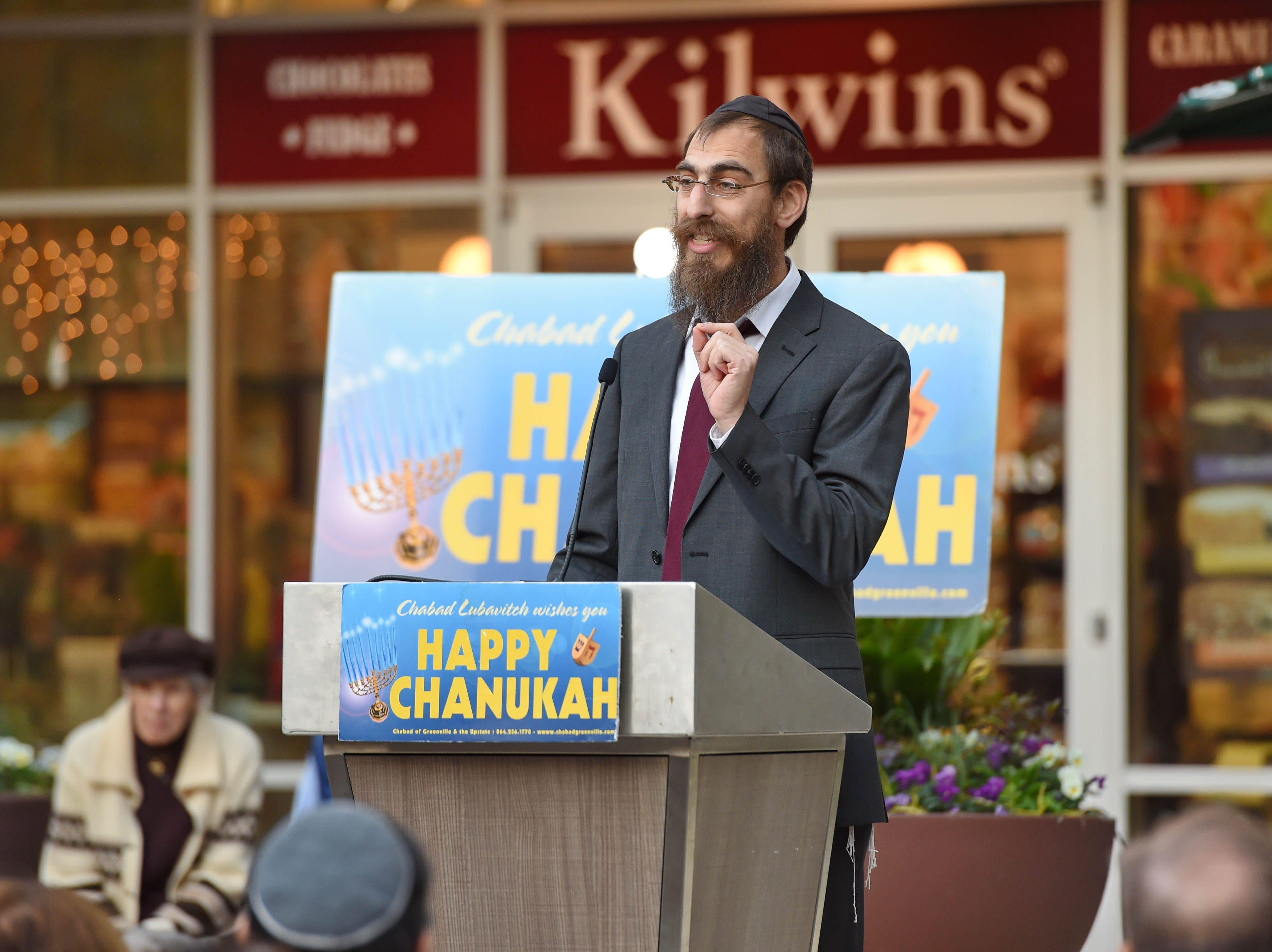 Rabbi Leibel Kesselman speaks to the crowd. The annual Jewish celebration of Chanukah was kicked off with the lighting of the Menorah at NOMA Square Sunday, Dec. 2, 2018.