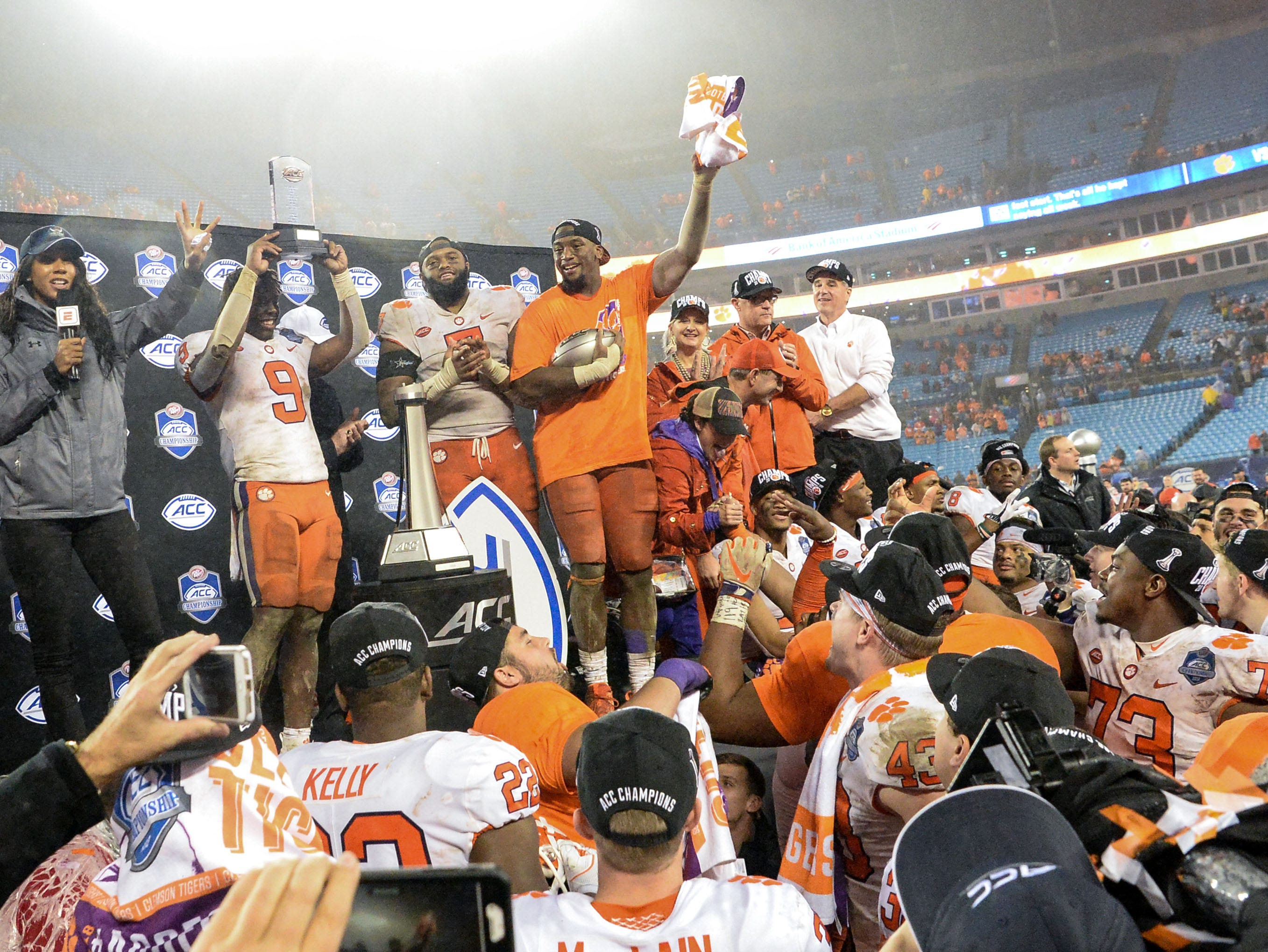 Clemson team and fans celebrate a 42-10 win over Pittsburgh after the game at the Dr. Pepper ACC football championship at Bank of America Stadium in Charlotte, N.C. on Saturday, December 1, 2018. Clemson running back Travis Etienne (9) holds up the MVP award.