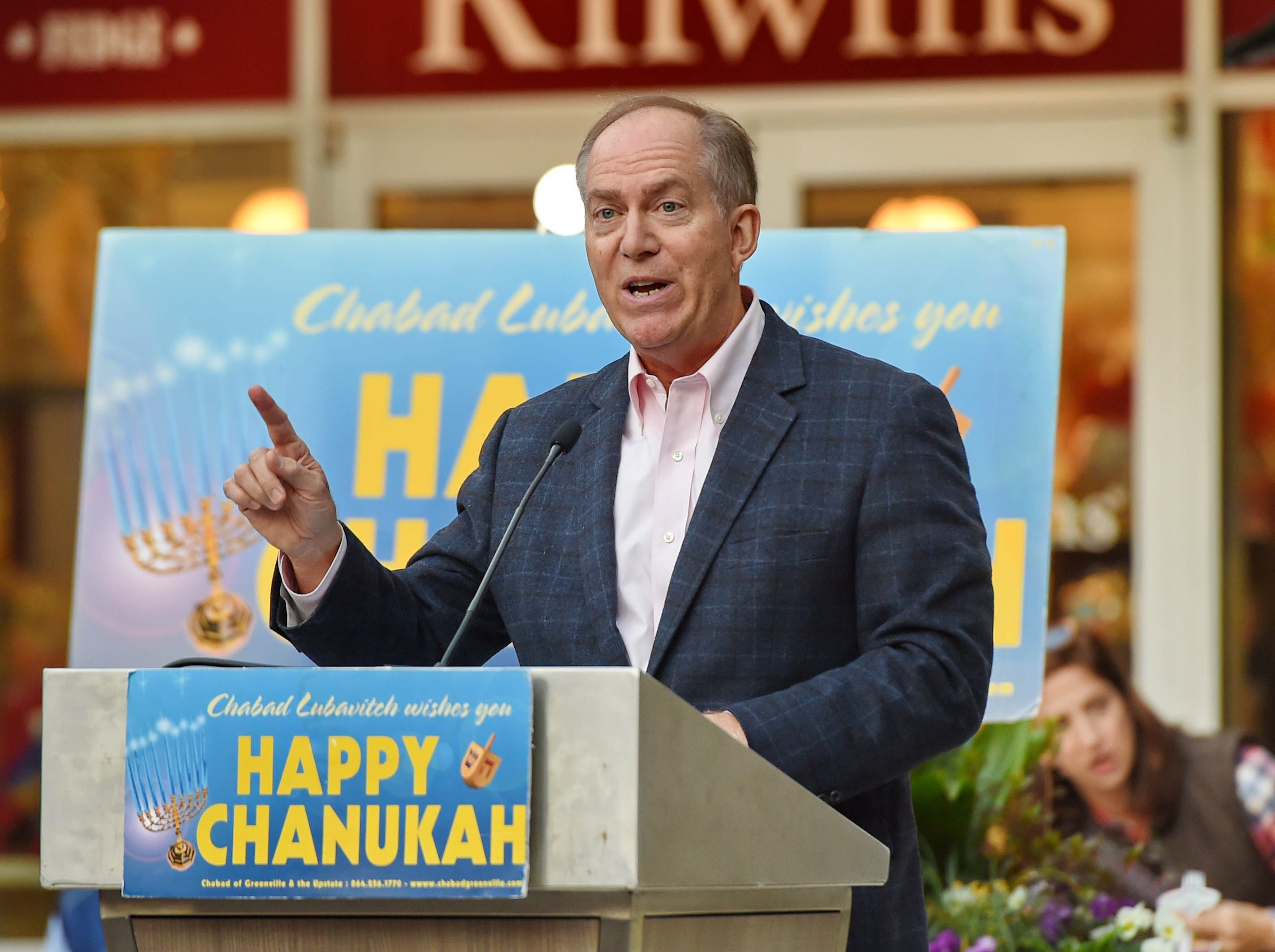 Mayor Knox White speaks to the crowd. The annual Jewish celebration of Chanukah was kicked off with the lighting of the Menorah at NOMA Square Sunday, Dec. 2, 2018.