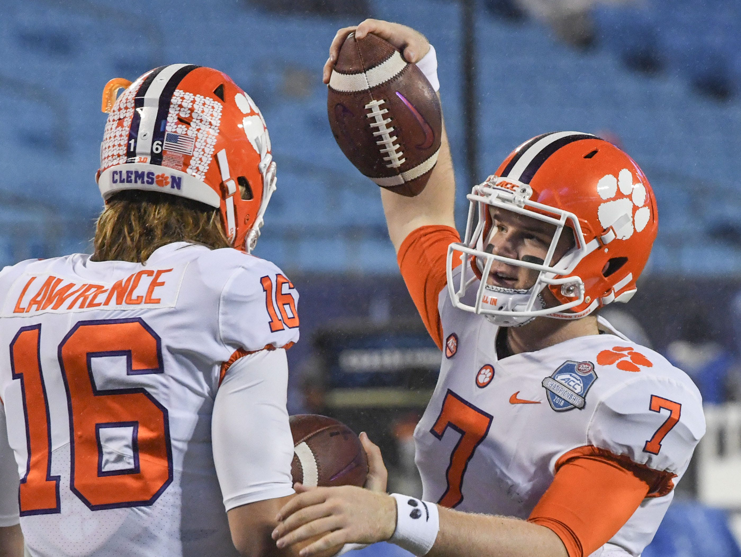 Clemson quarterback Trevor Lawrence (16) and quarterback Chase Brice (7) warm up before the game of the Dr. Pepper ACC football championship at Bank of America Stadium in Charlotte, N.C. on Saturday, December 1, 2018.