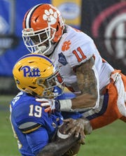 Clemson safety Isaiah Simmons (11) tackles Pittsburgh tight end Jake Zilinskas(19) during the second quarter of the Dr. Pepper ACC football championship at Bank of America Stadium in Charlotte, N.C. on Saturday, December 1, 2018.