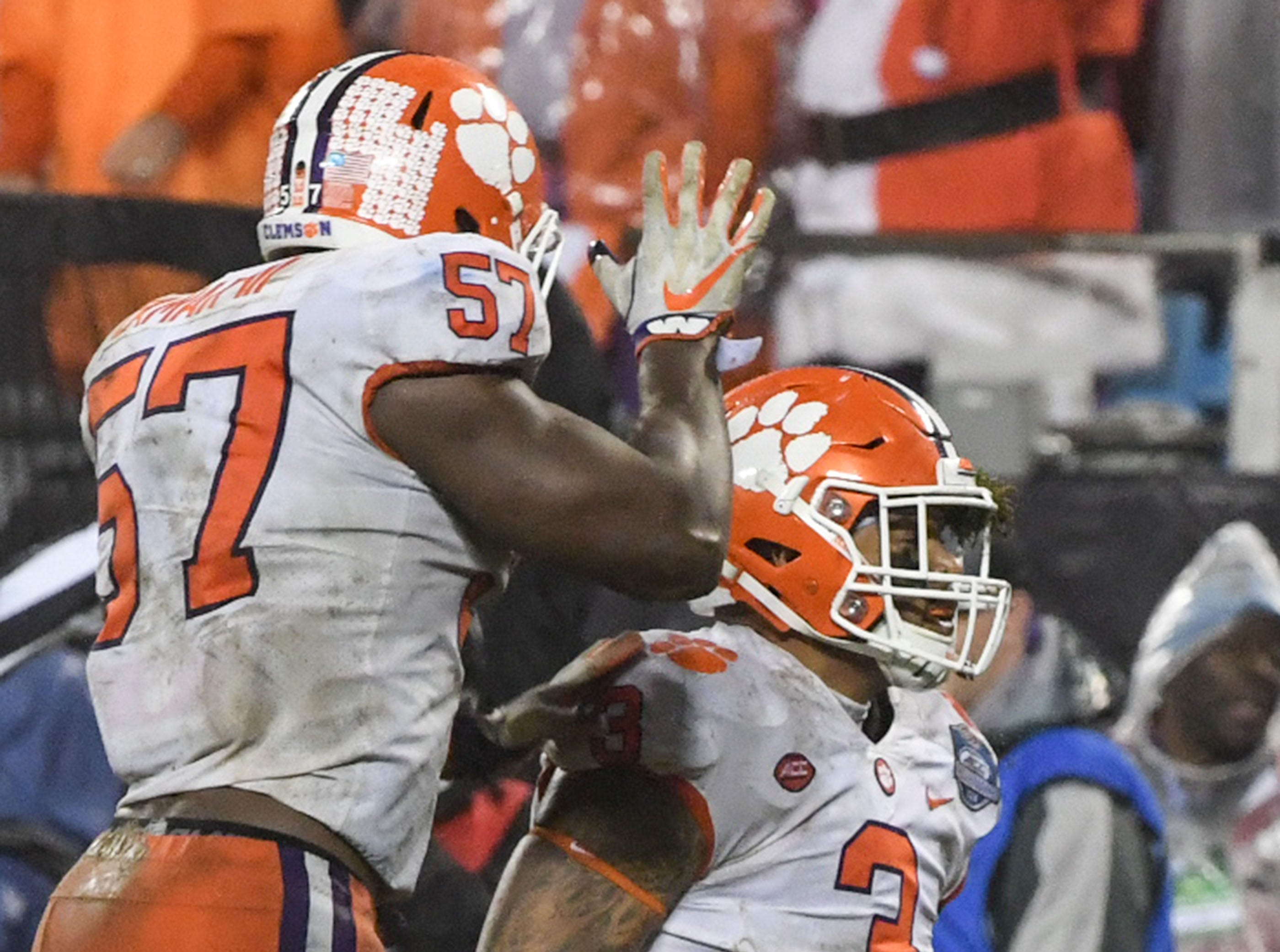 Clemson linebacker Tre Lamar (57) congratulates defensive lineman Xavier Thomas (3) on his tackle during the third quarter of the Dr. Pepper ACC football championship at Bank of America Stadium in Charlotte, N.C. on Saturday, December 1, 2018.