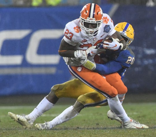 Clemson running back Lyn-J Dixon (23) runs during the fourth quarter of the Dr. Pepper ACC football championship at Bank of America Stadium in Charlotte, N.C. on Saturday, December 1, 2018.