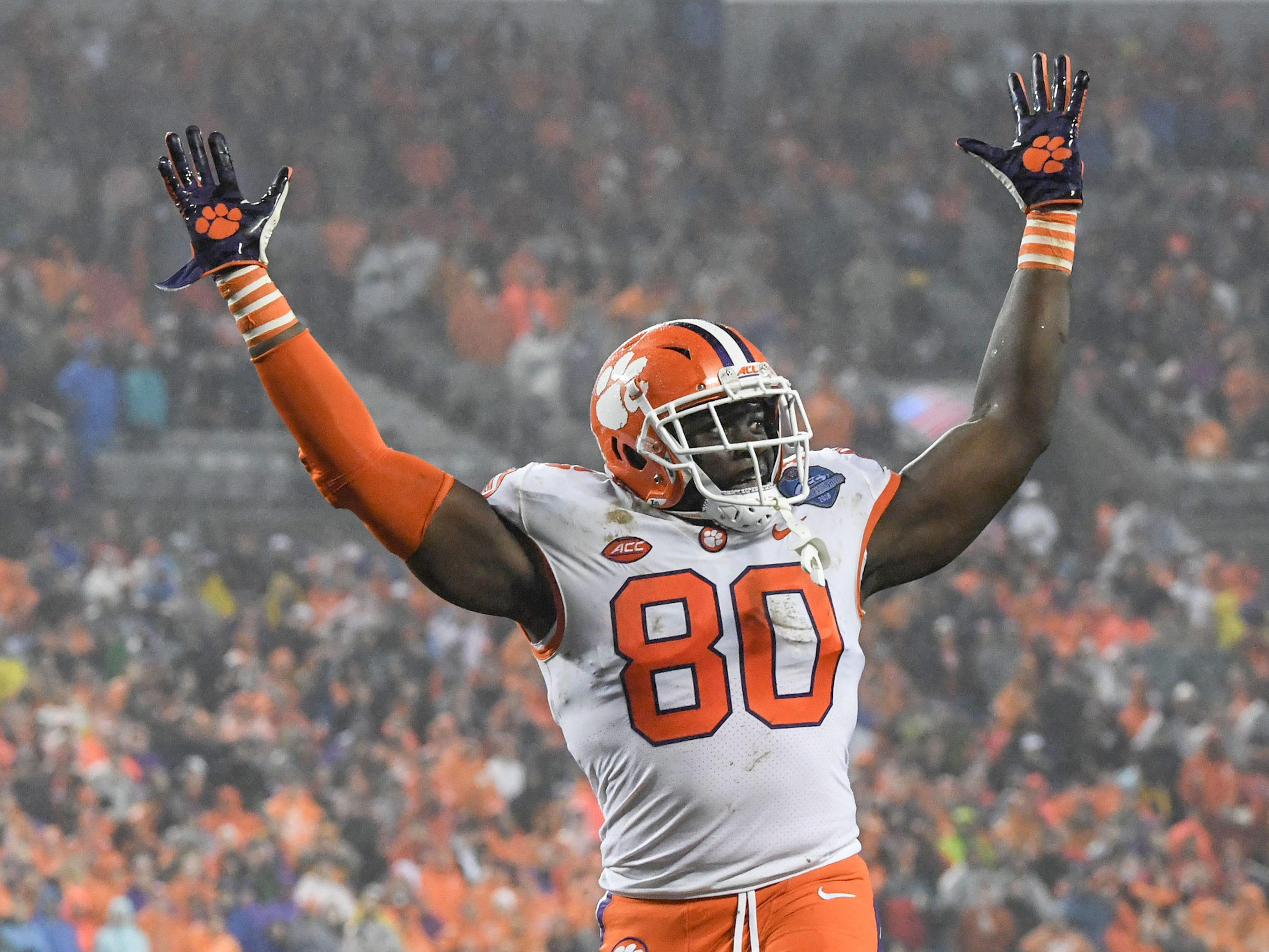 Clemson tight end Milan Richard (80) raises his arms during the fourth quarter of the Dr. Pepper ACC football championship at Bank of America Stadium in Charlotte, N.C. on Saturday, December 1, 2018.