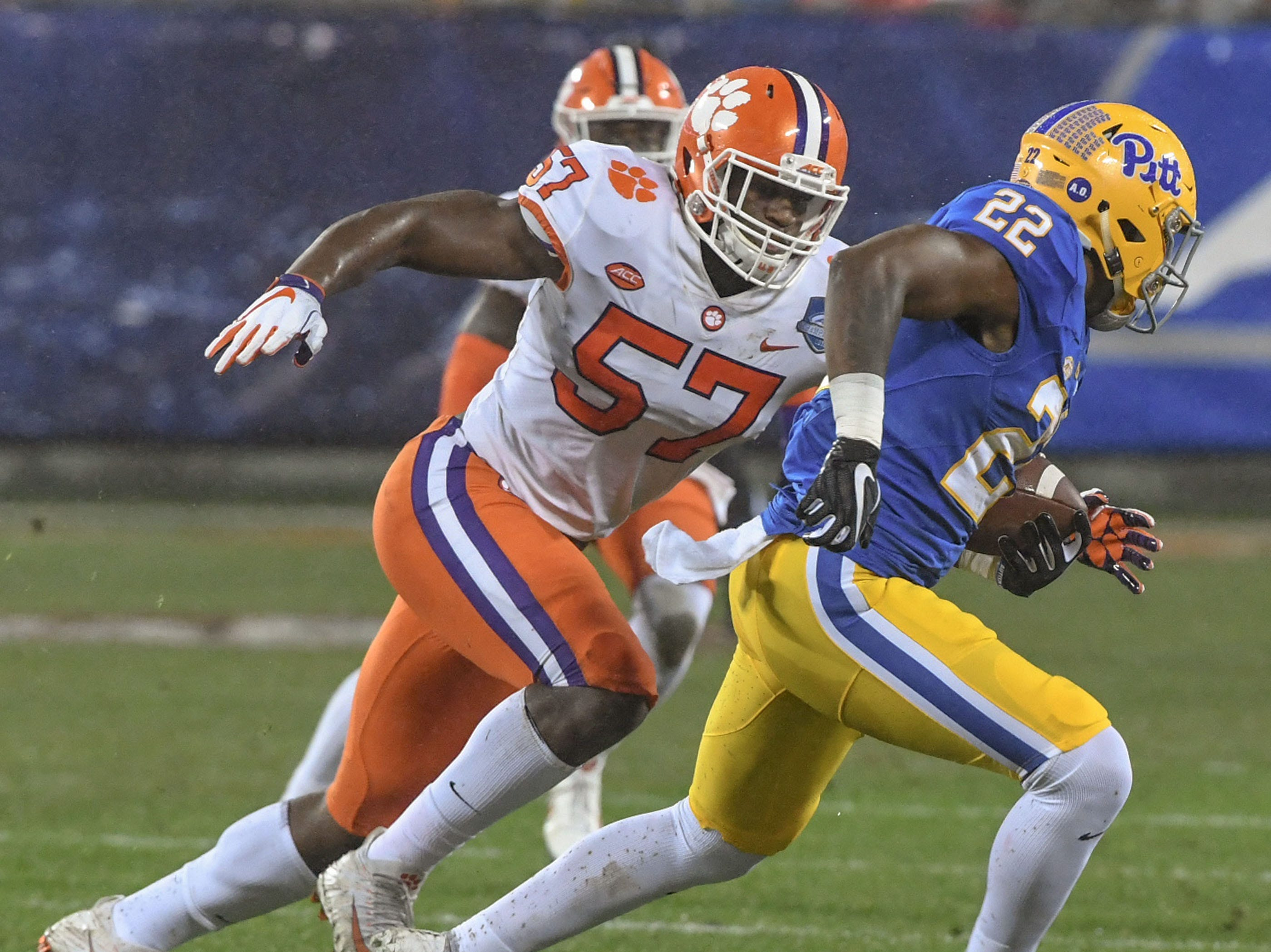Clemson linebacker Tre Lamar (57) chases Pittsburgh running back Darrin Hall(22) during the third quarter of the Dr. Pepper ACC football championship at Bank of America Stadium in Charlotte, N.C. on Saturday, December 1, 2018.