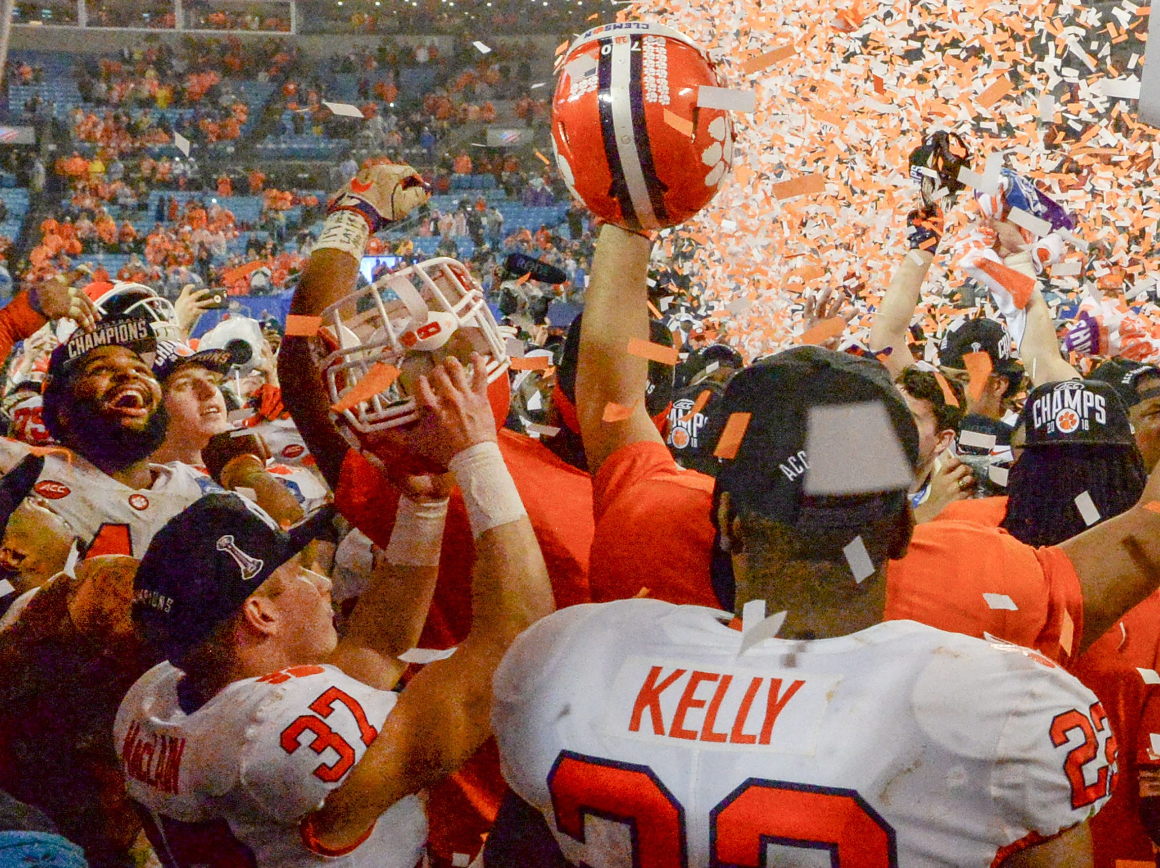 Clemson defensive lineman Christian Wilkins (42), left, team and fans celebrate a 42-10 win over Pittsburgh after the game at the Dr. Pepper ACC football championship at Bank of America Stadium in Charlotte, N.C. on Saturday, December 1, 2018.