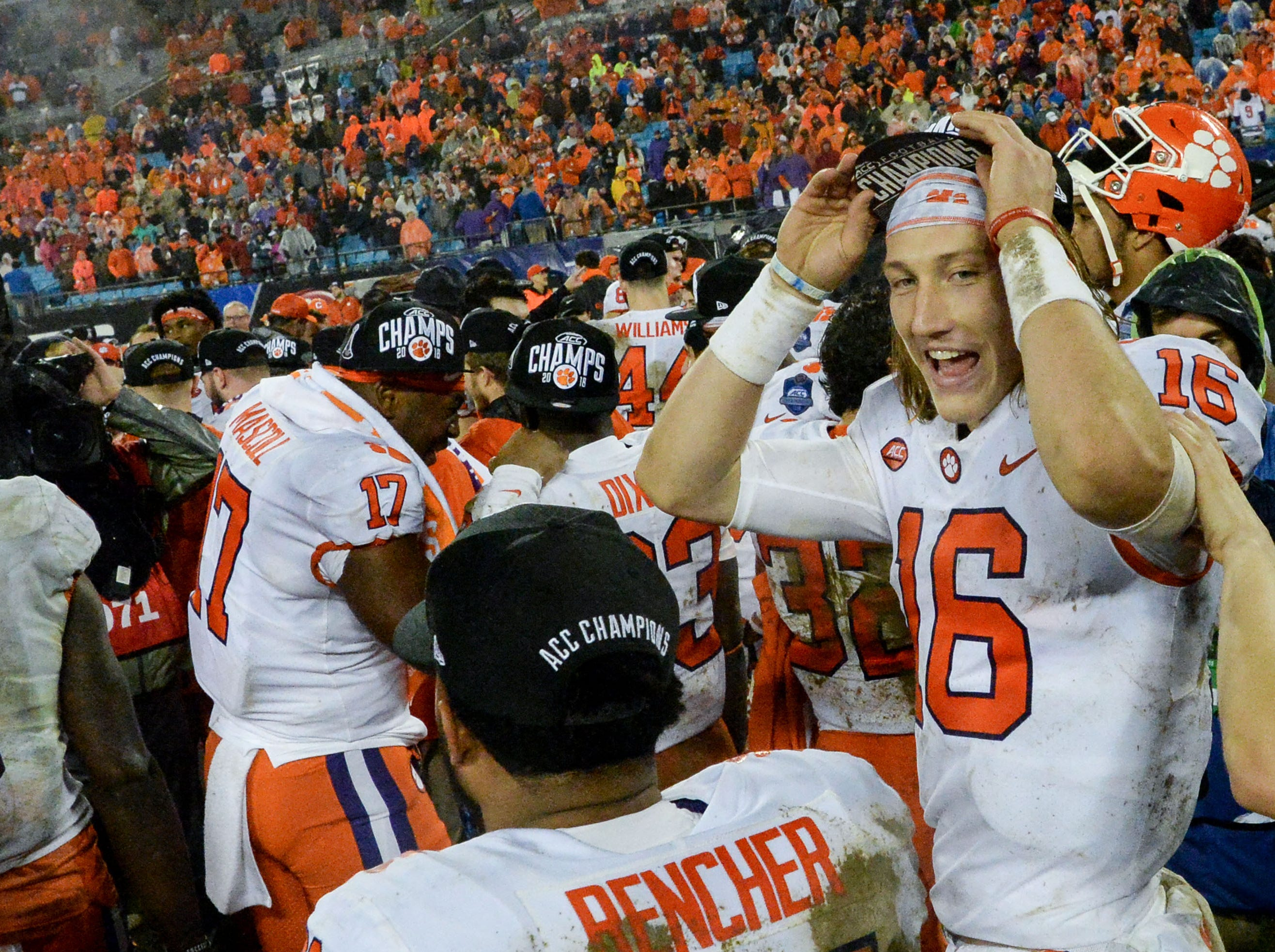 Clemson quarterback Trevor Lawrence (16) and teammates celebrate after the game at the Dr. Pepper ACC football championship at Bank of America Stadium in Charlotte, N.C. on Saturday, December 1, 2018.