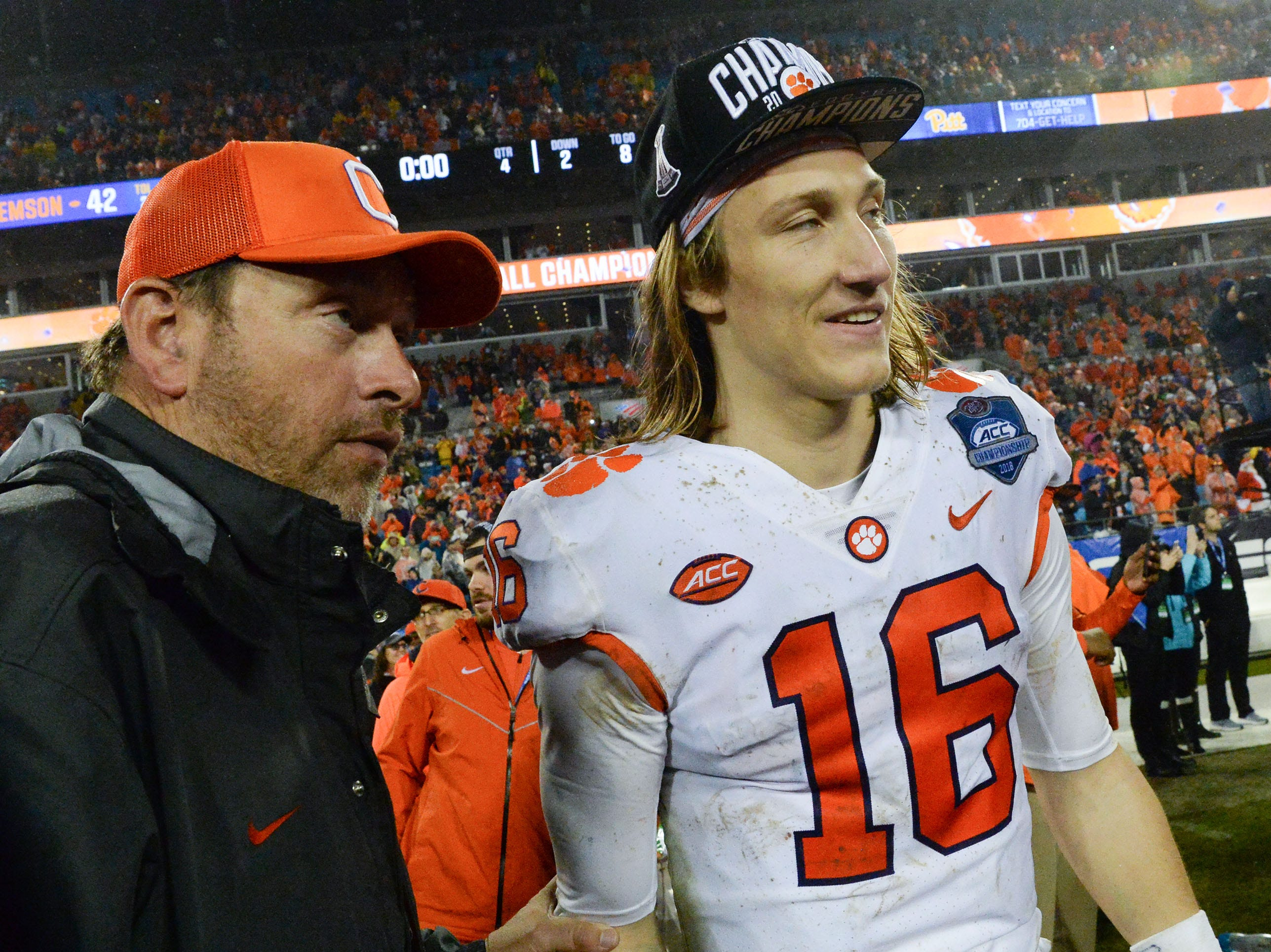 Former Clemson quarterback Rodney Williams, left, and quarterback Trevor Lawrence (16) after the game at the Dr. Pepper ACC football championship at Bank of America Stadium in Charlotte, N.C. on Saturday, December 1, 2018.