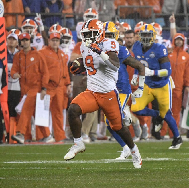 Clemson running back Travis Etienne (9) runs the first play from scrimmage 75 yards for a touchdown against Pitt during the first quarter of the Dr. Pepper ACC football championship at Bank of America Stadium in Charlotte, N.C. on Saturday, December 1, 2018.