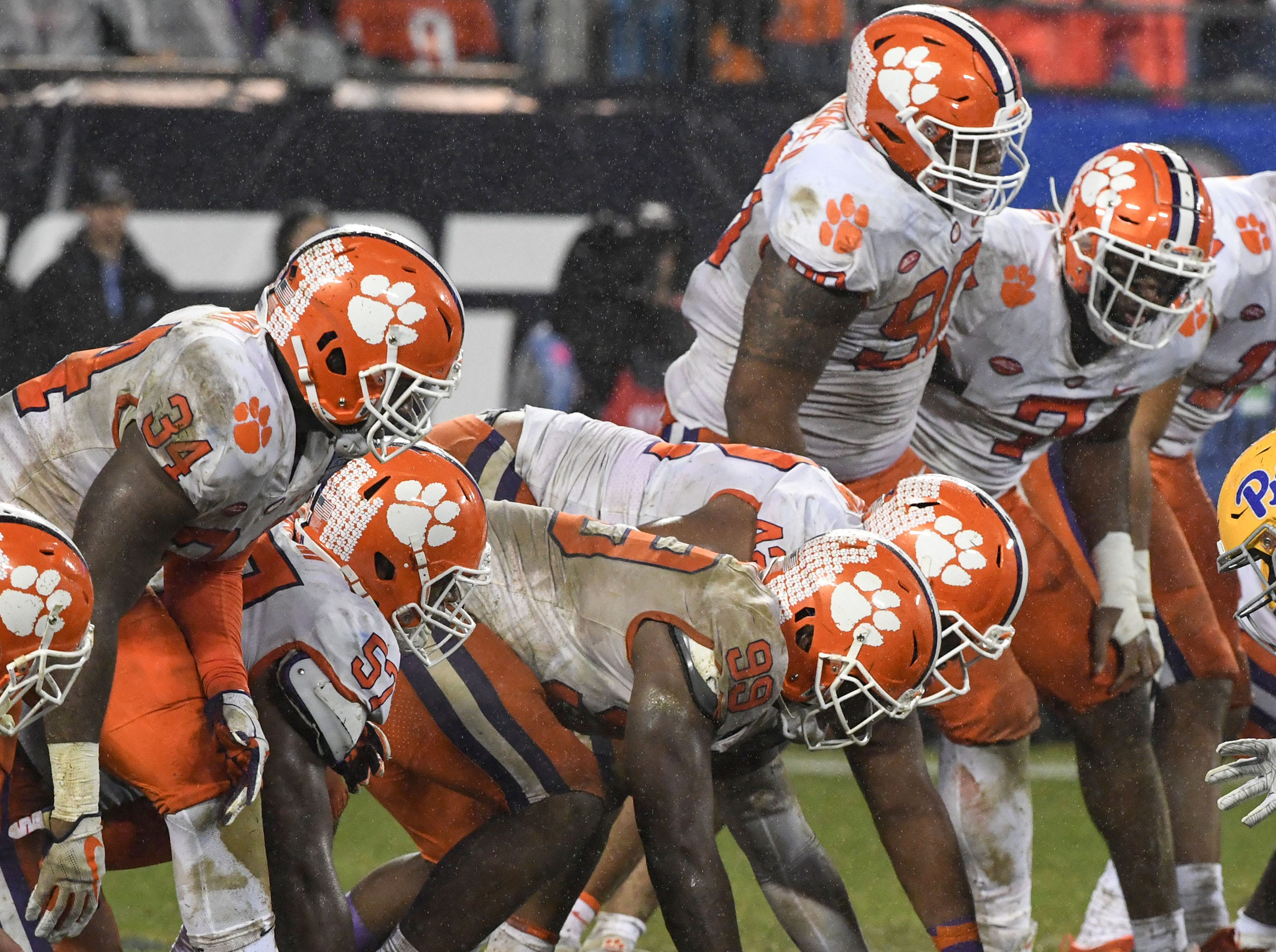 Clemson defensive linemen stack up for a play against Pittsburgh during the third quarter of the Dr. Pepper ACC football championship at Bank of America Stadium in Charlotte, N.C. on Saturday, December 1, 2018.