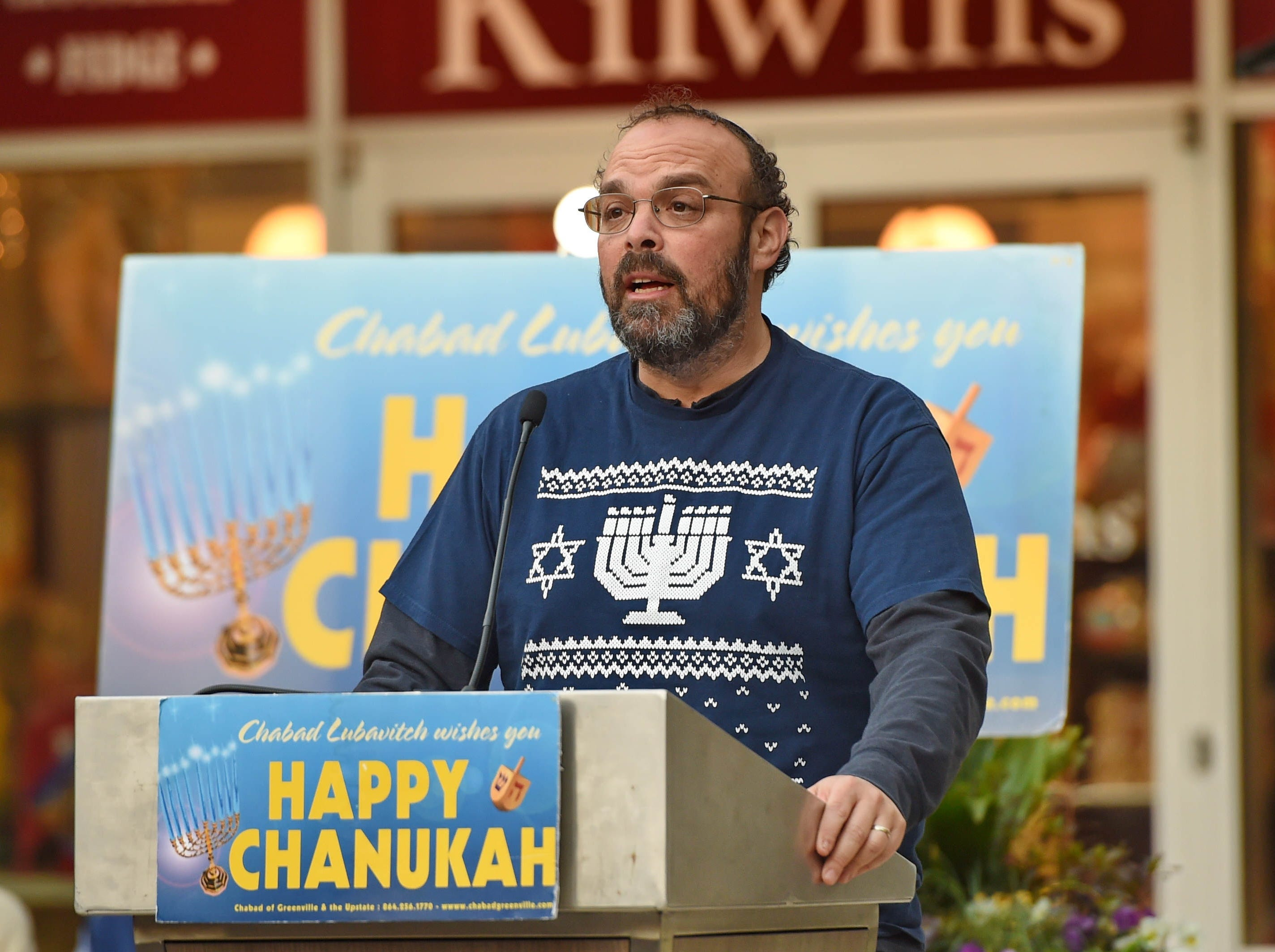 Rabbi Mathew Markos leads the crowd in a prayer for peace. The annual Jewish celebration of Chanukah was kicked off with the lighting of the Menorah at NOMA Square Sunday, Dec. 2, 2018.