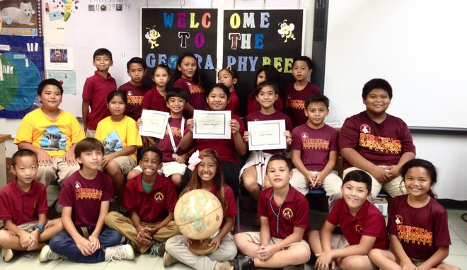On Nov. 29 Capt. H.B. Price School held its annual geography bee. Twenty-one students answered 50 questions. Pictured seated from left: Kevin Zhang, Robert O'Brien, Misiah Murphy, Mollysky Dahilig, Ioane Camacho, Slade DeGracia, and Abigail Lopez. Middle row seated from left: Dano Pangelinan, Felicita Pangelinan, Taga Blas first place, Samara Bongato second place, Taelor Mafnas third place, Preston Pangelinan, and Felix Ulloa.  Back row standing from left: Savian Sablan, Drady Cruz, Isabel Reyes, Sophia Nangauta, Cyan Sablan, Vayla Gumabon (partially hidden), and Skyler Francisco.