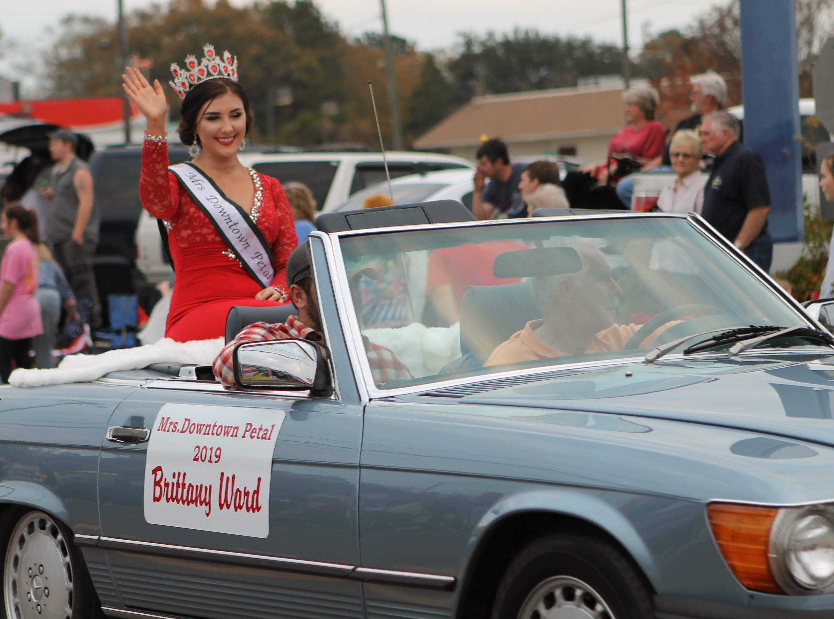 Miss Downtown Petal 2019, Brittany Ward, waves to the crowd of the Petal Christmas Parade on Saturday, December 1, 2018.
