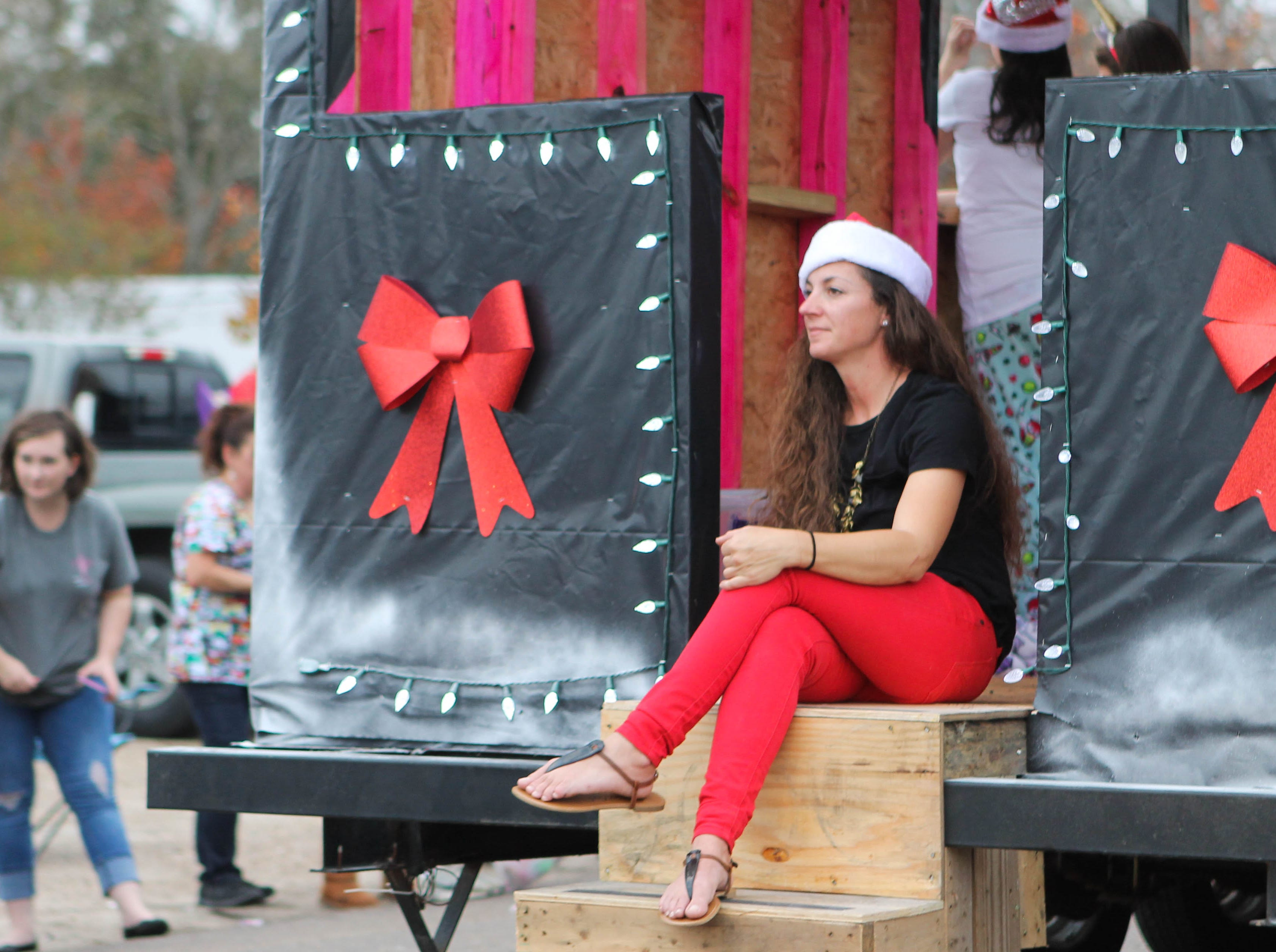A woman sits on the back of a parade float at the Petal Christmas Parade on Saturday, December 1, 2018.