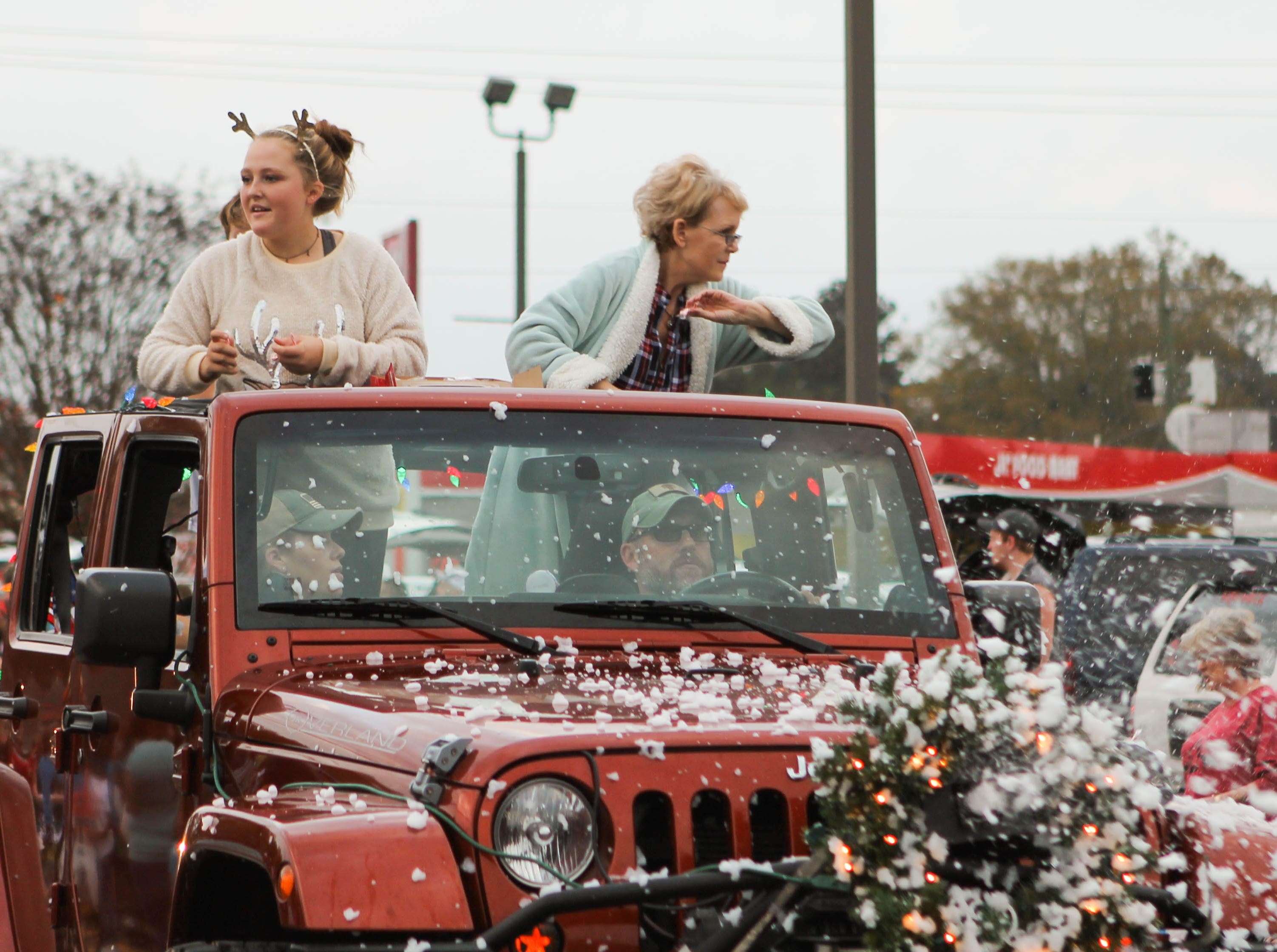 Women throw candy to the crowd of the Petal Christmas Parade on Saturday, December 1, 2018.
