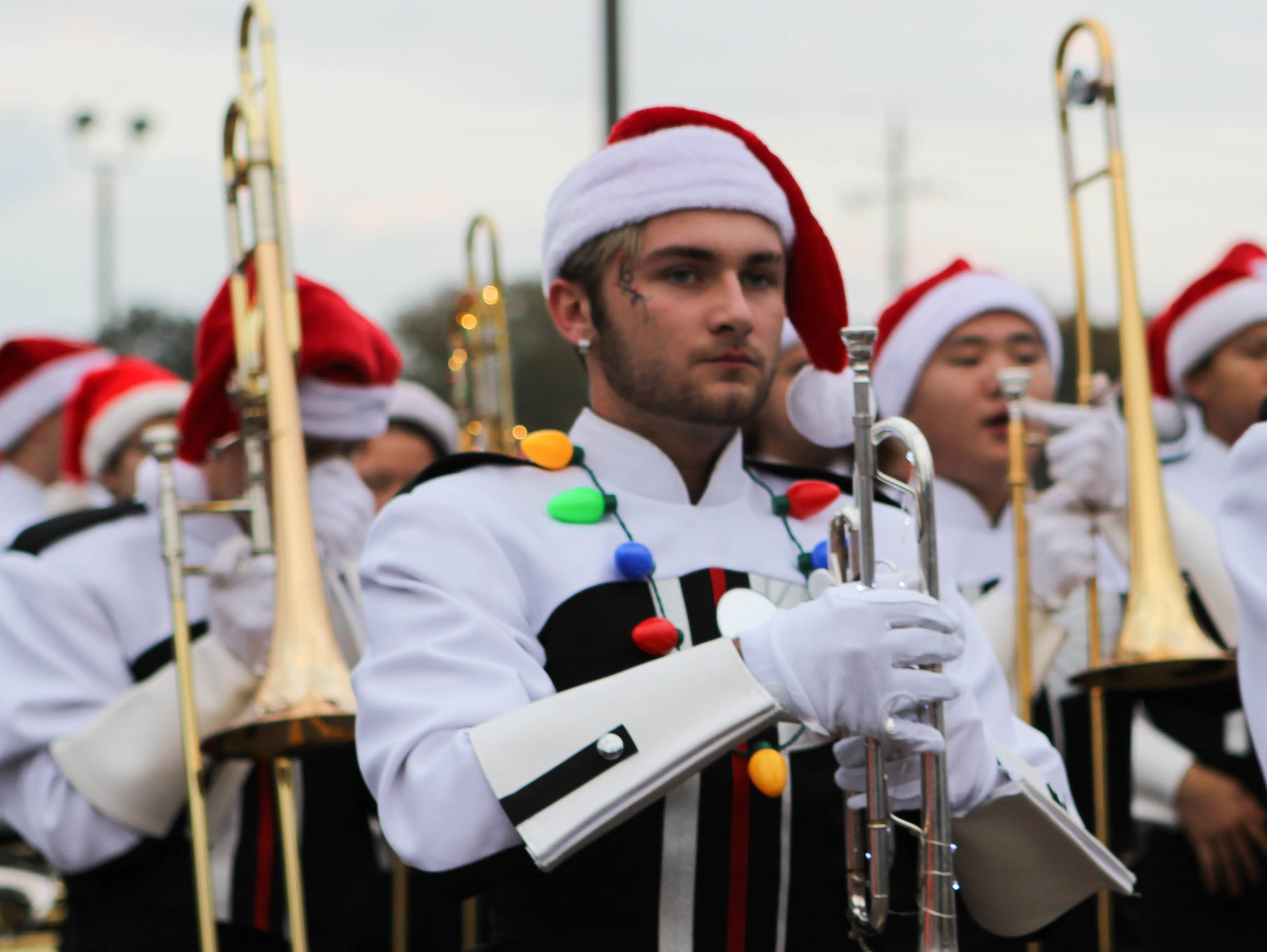 A trumpet player of the Petal High School Marching Band marches in the Petal Christmas Parade on Saturday, December 1, 2018.