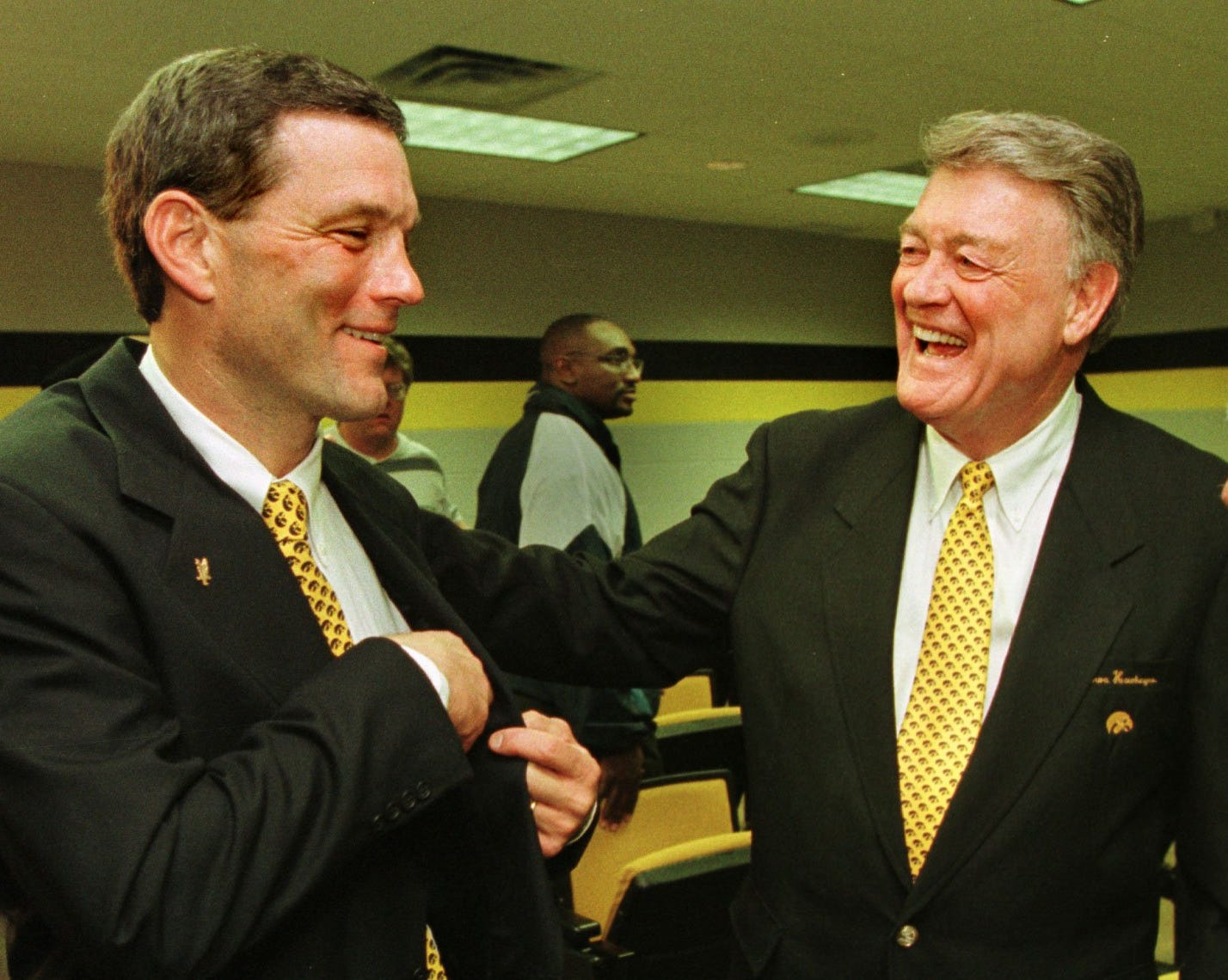 From 1998: Retired Iowa football coach Hayden Fry, right, was on hand to welcome his former assistant, Kirk Ferentz, as his successor with the Hawkeyes. Ferentz served as Iowa's offensive line coach under Fry from 1981 to 1989.