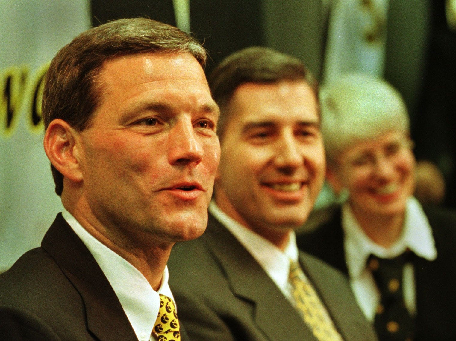New Iowa Hawkeyes football coach Kirk Ferentz, left, answers a question at a press conference announcing his appointment on Dec. 3, 1998. With him are UI Athletic Director Bob Bowlsby and UI President Mary Sue Coleman.