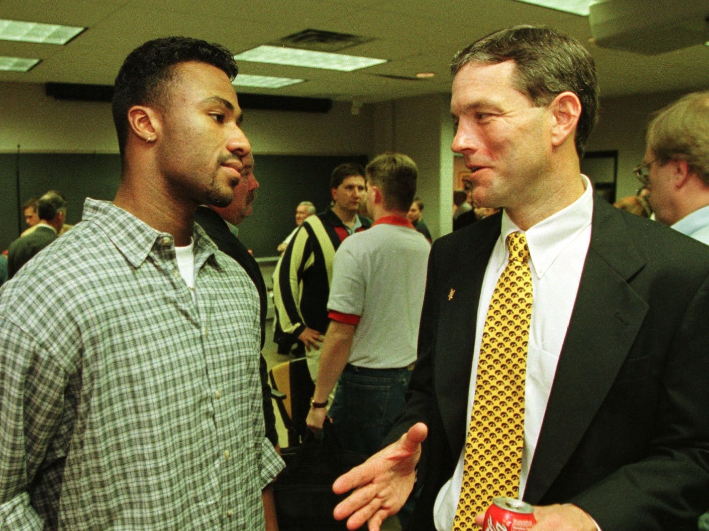From 1998: New Iowa football coach Kirk Ferentz talks with Hawkeyes wide receiver Kahlil Hill following the press conference in Iowa City where Ferentz was introduced.