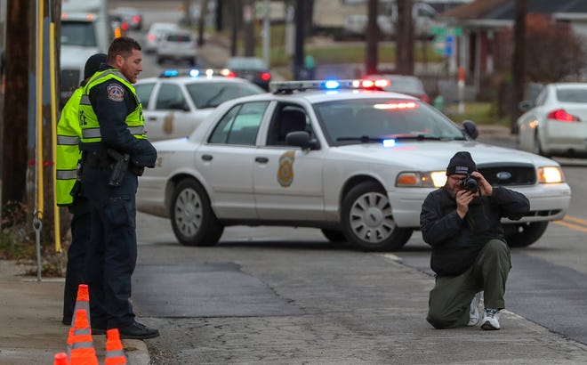 IMPD investigates at the scene where a teenage pedestrian was struck along 10th Street in Indianapolis, on Monday, Dec. 3, 2018.
