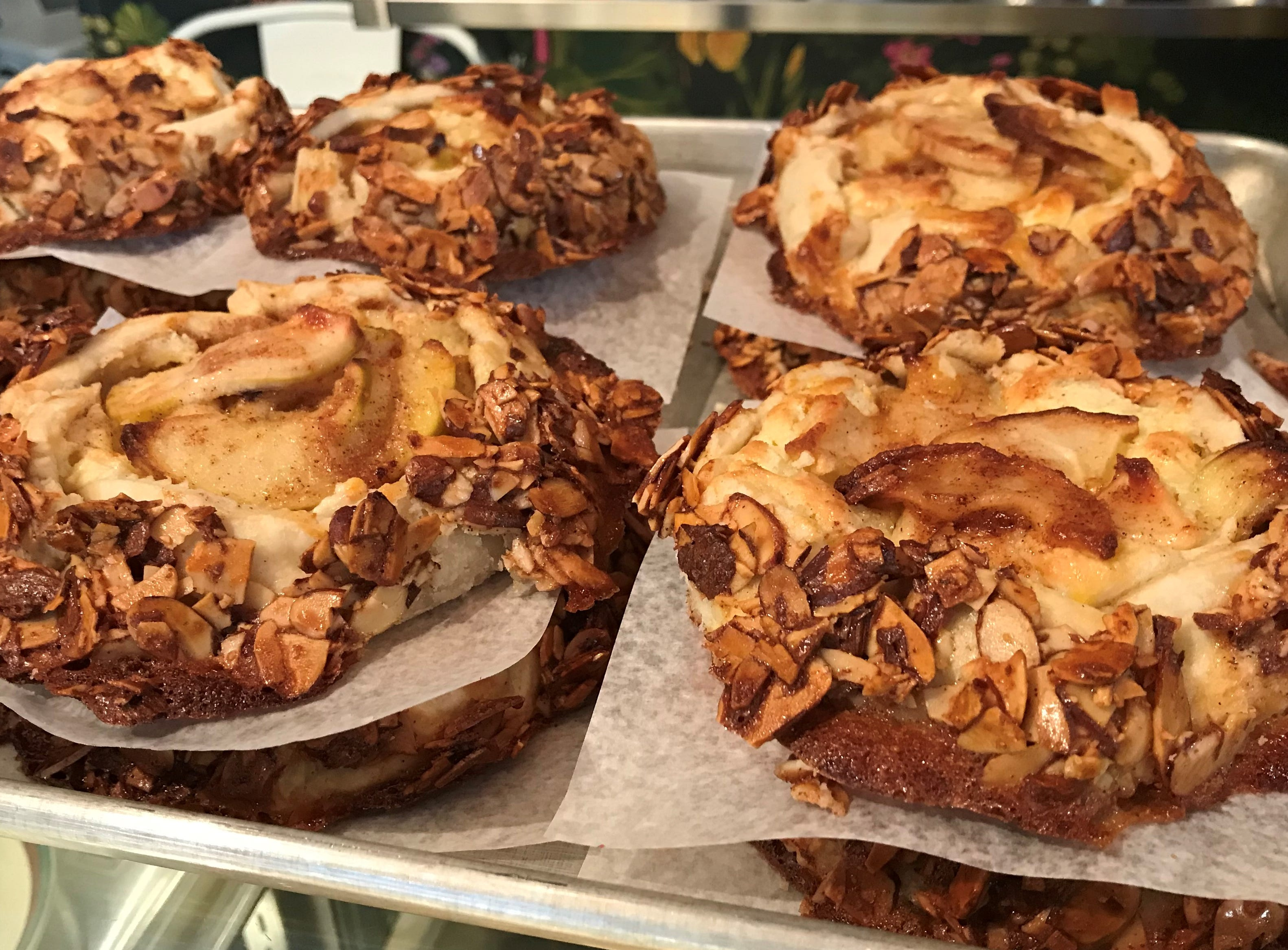 Apple galettes coated in almond brittle at Pots & Pans Pie  Co. in Indianapolis. The bakery opened a cafe and retail shop Dec. 1, 2018. The store, south of Broad Ripple, is at 915 N. College  Ave., at 49th Street.