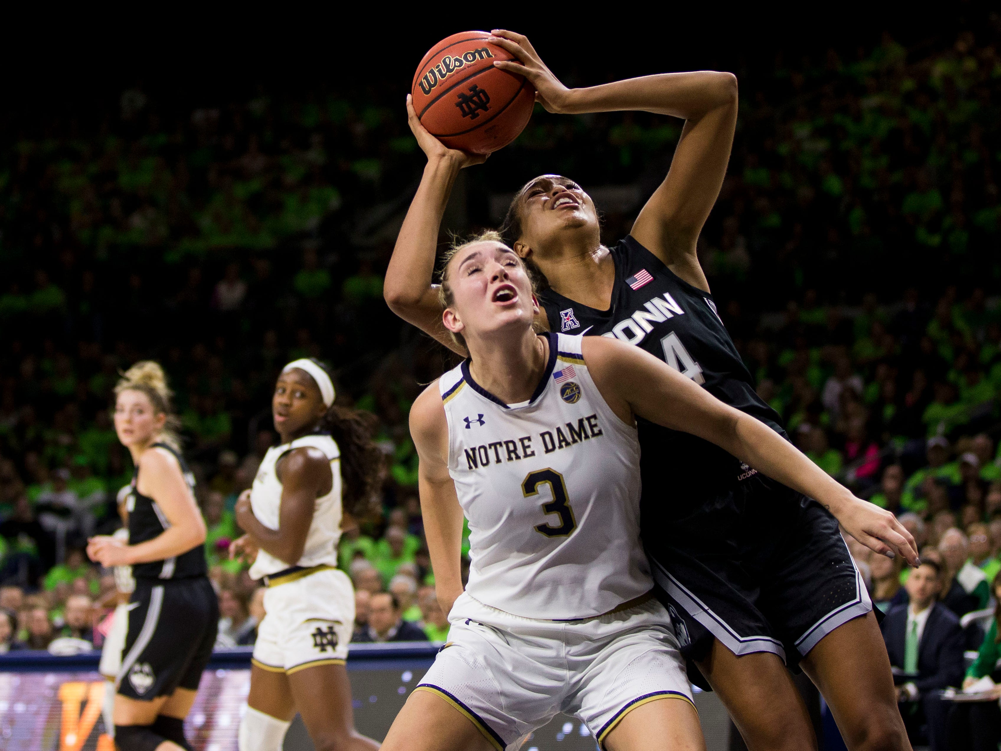 Connecticut's Napheesa Collier (24) shoots over Notre Dame's Marina Mabrey (3) during the first half of an NCAA college basketball game Sunday, Dec. 2, 2018, in South Bend, Ind.